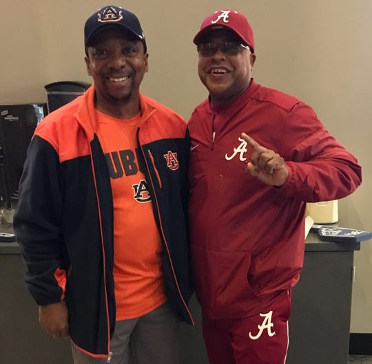 Auburn fan Terry Townsend, left, and Alabama fan Greg Sanderfer have been close friends since childhood. They were at Bridgestone Arena Friday to see their teams play in quarterfinal games.