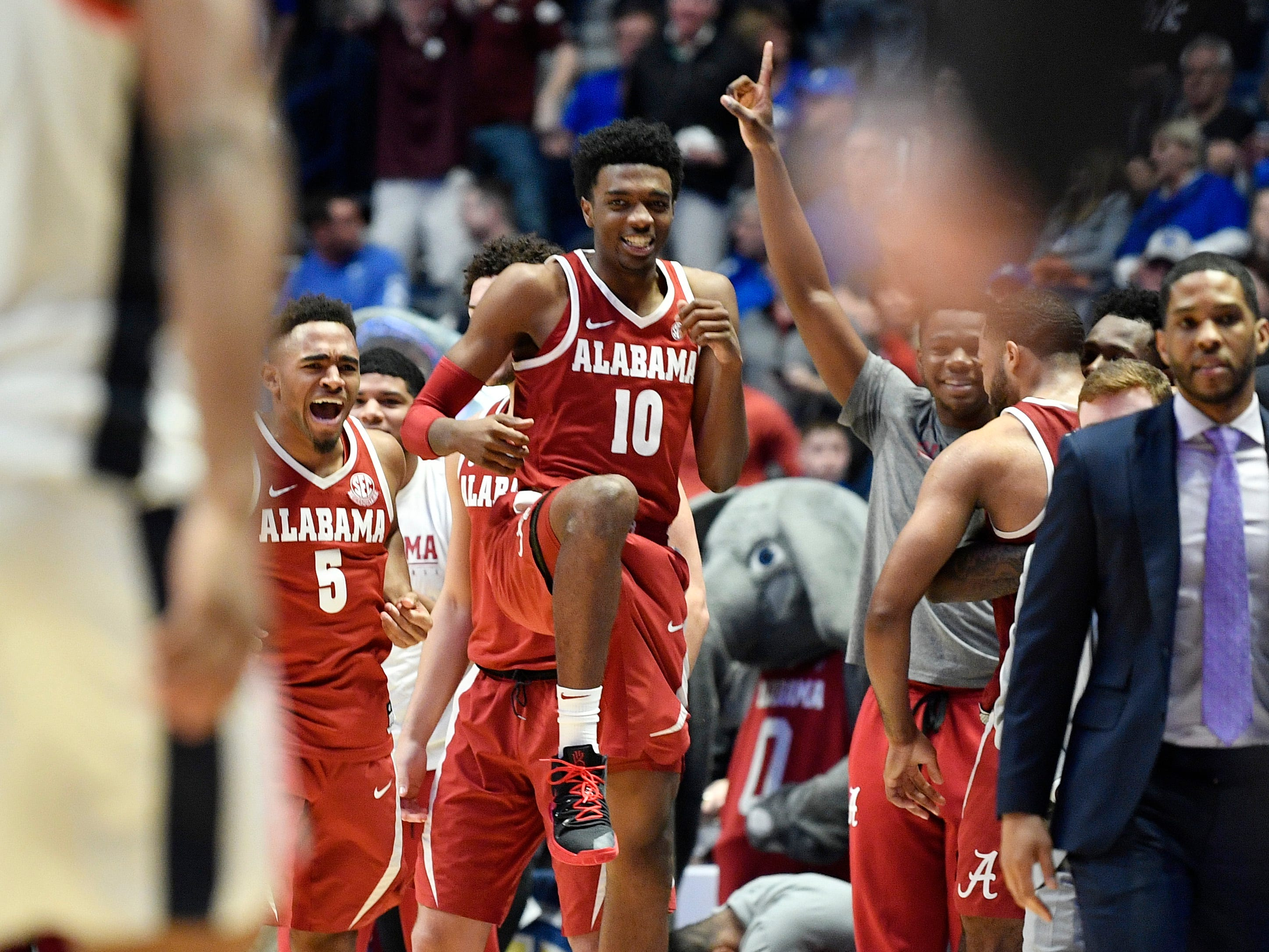 Alabama players celebrate their win over Ole Miss in during the SEC Men's Basketball Tournament at Bridgestone Arena in Nashville, Tenn., Thursday, March 14, 2019.