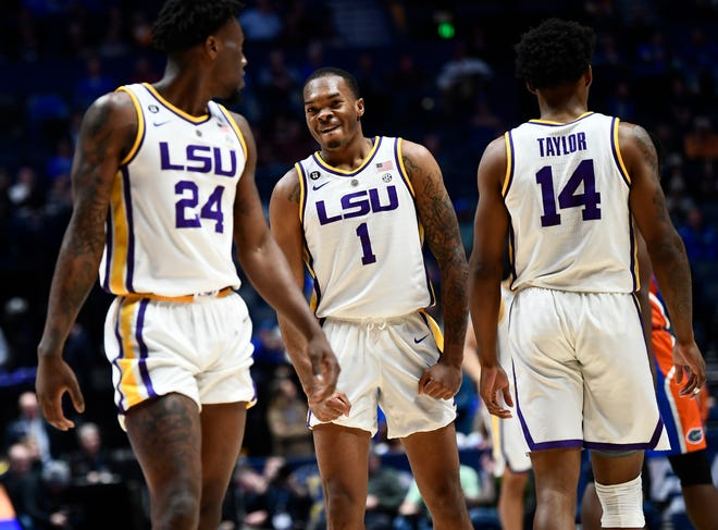 LSU guard Javonte Smart (1) celebrates a basket with forward Emmitt Williams (24) and guard Marlon Taylor (14) during the first half of the SEC Men's Basketball Tournament game at Bridgestone Arena in Nashville, Tenn., Friday, March 15, 2019.