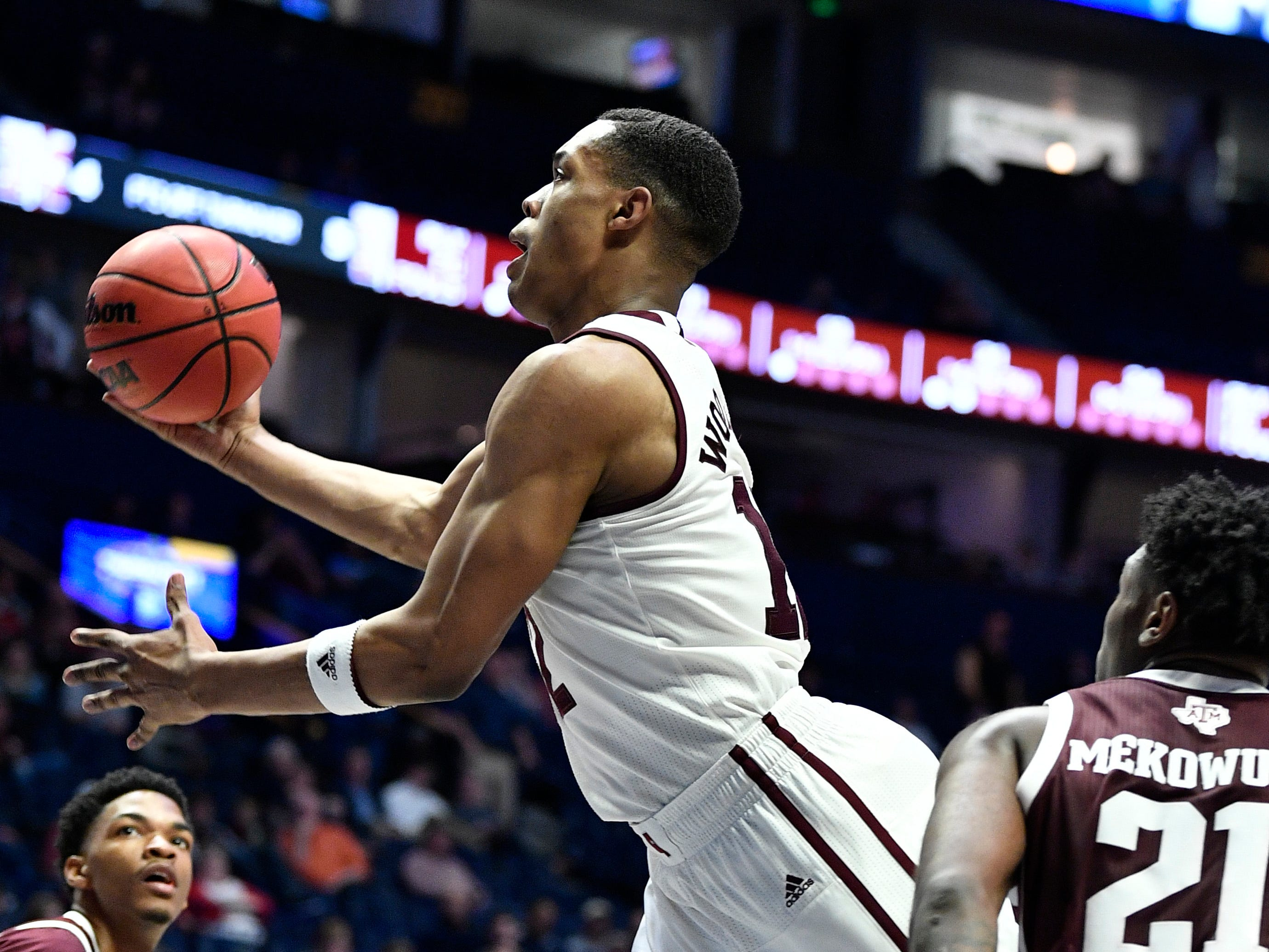 Mississippi State guard Robert Woodard (12) goes up for a shot during the second half of the SEC Men's Basketball Tournament game at Bridgestone Arena in Nashville, Tenn., Thursday, March 14, 2019.