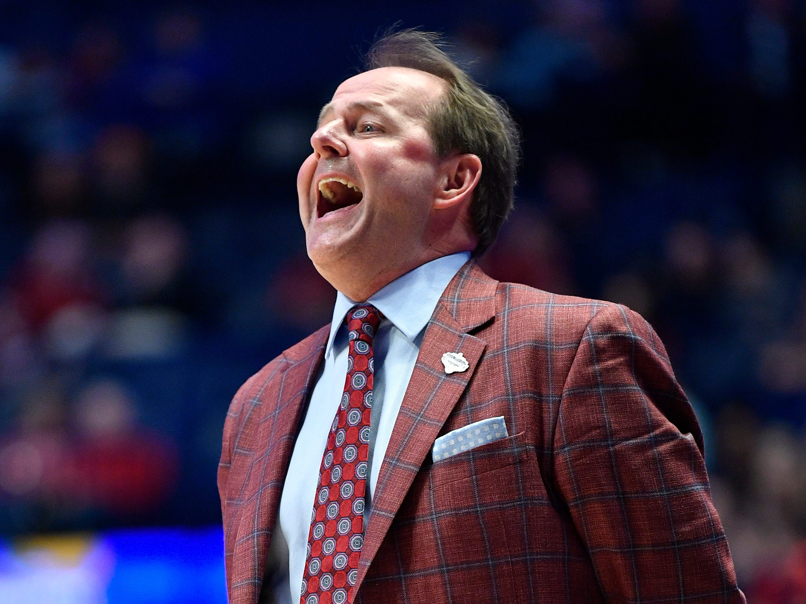 Ole Miss head coach Kermit Davis yells to his team during the first half of the SEC Men's Basketball Tournament game at Bridgestone Arena in Nashville, Tenn., Thursday, March 14, 2019.