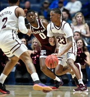 Mississippi State guard Tyson Carter (23) moves the bal defended by Texas A&M guard Jay Jay Chandler (0) during the first half of the SEC Men's Basketball Tournament game at Bridgestone Arena in Nashville, Tenn., Thursday, March 14, 2019.