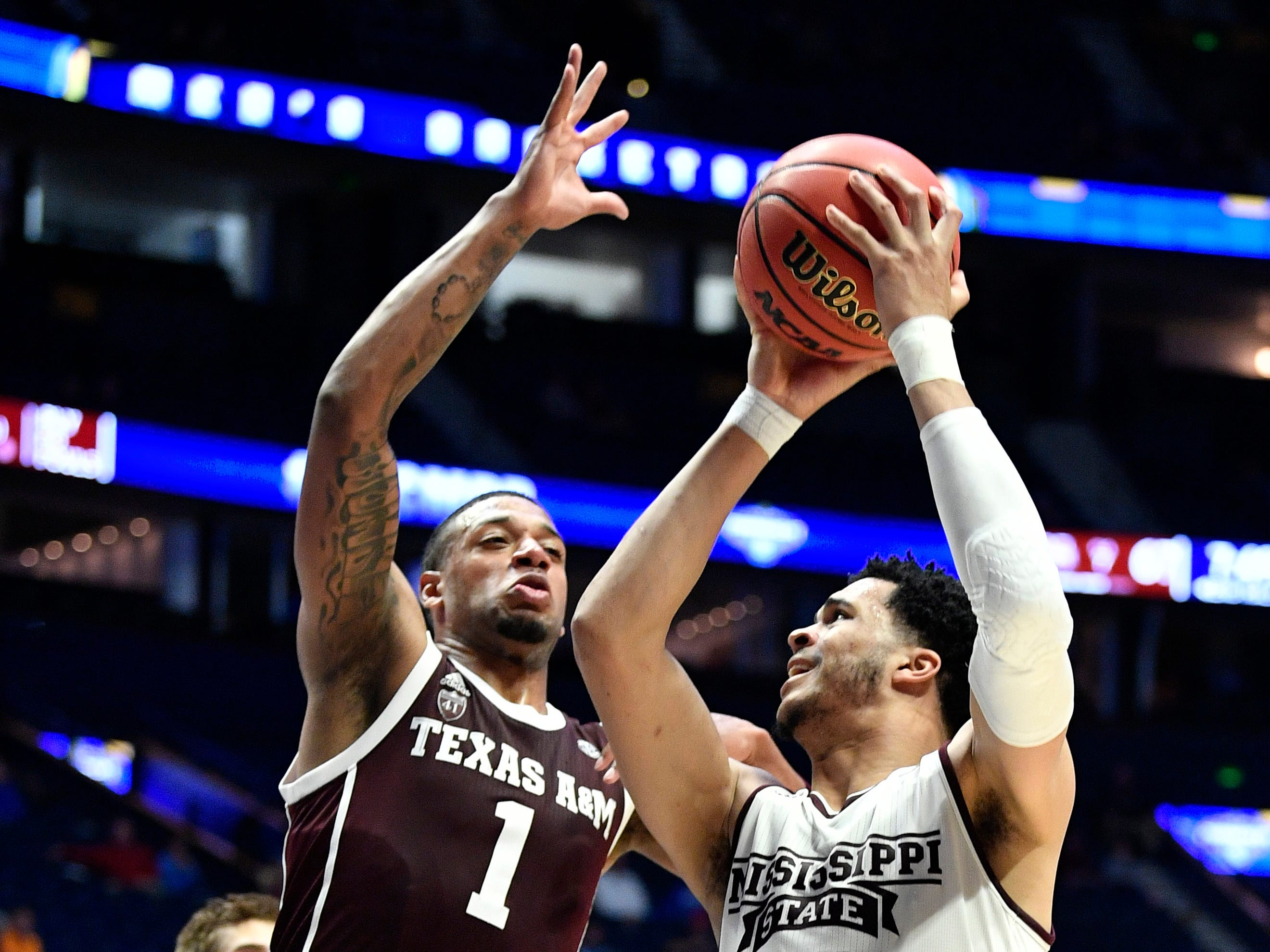 Mississippi State guard Quinndary Weatherspoon (11) looks to shoot defended by Texas A&M guard Savion Flagg (1) during the second half of the SEC Men's Basketball Tournament game at Bridgestone Arena in Nashville, Tenn., Thursday, March 14, 2019.