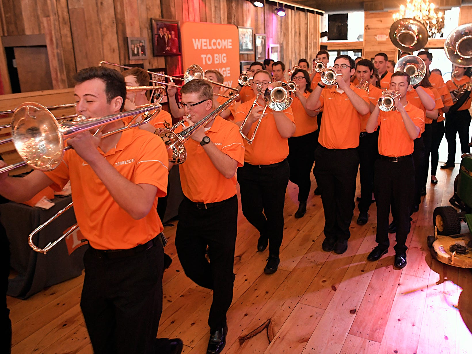 The University of Tennessee pep band marches into the George Jones Rooftop Bar during a fan pep rally during the SEC Men's Basketball Tournament in Nashville on Friday, March 15, 2019.