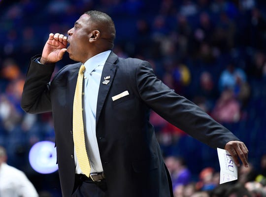 LSU interim head coach Tony Benford yells to his team during the first half of the SEC Men's Basketball Tournament game at Bridgestone Arena in Nashville, Tenn., Friday, March 15, 2019.