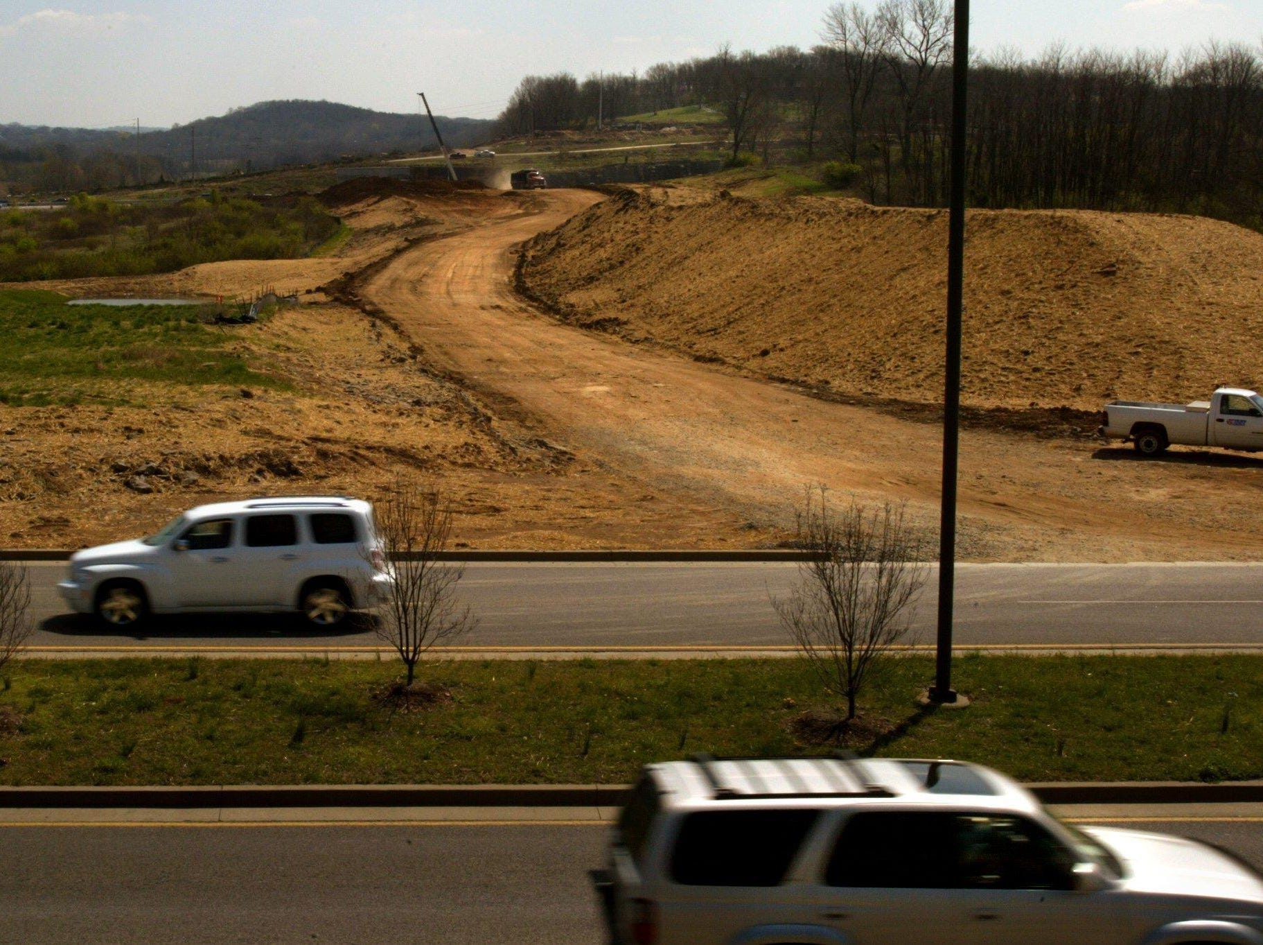 Motorists drive past the future McEwen interchange on Mallory Lane in Cool Springs in 2006. The construction has drawn interest from business developers for the area.