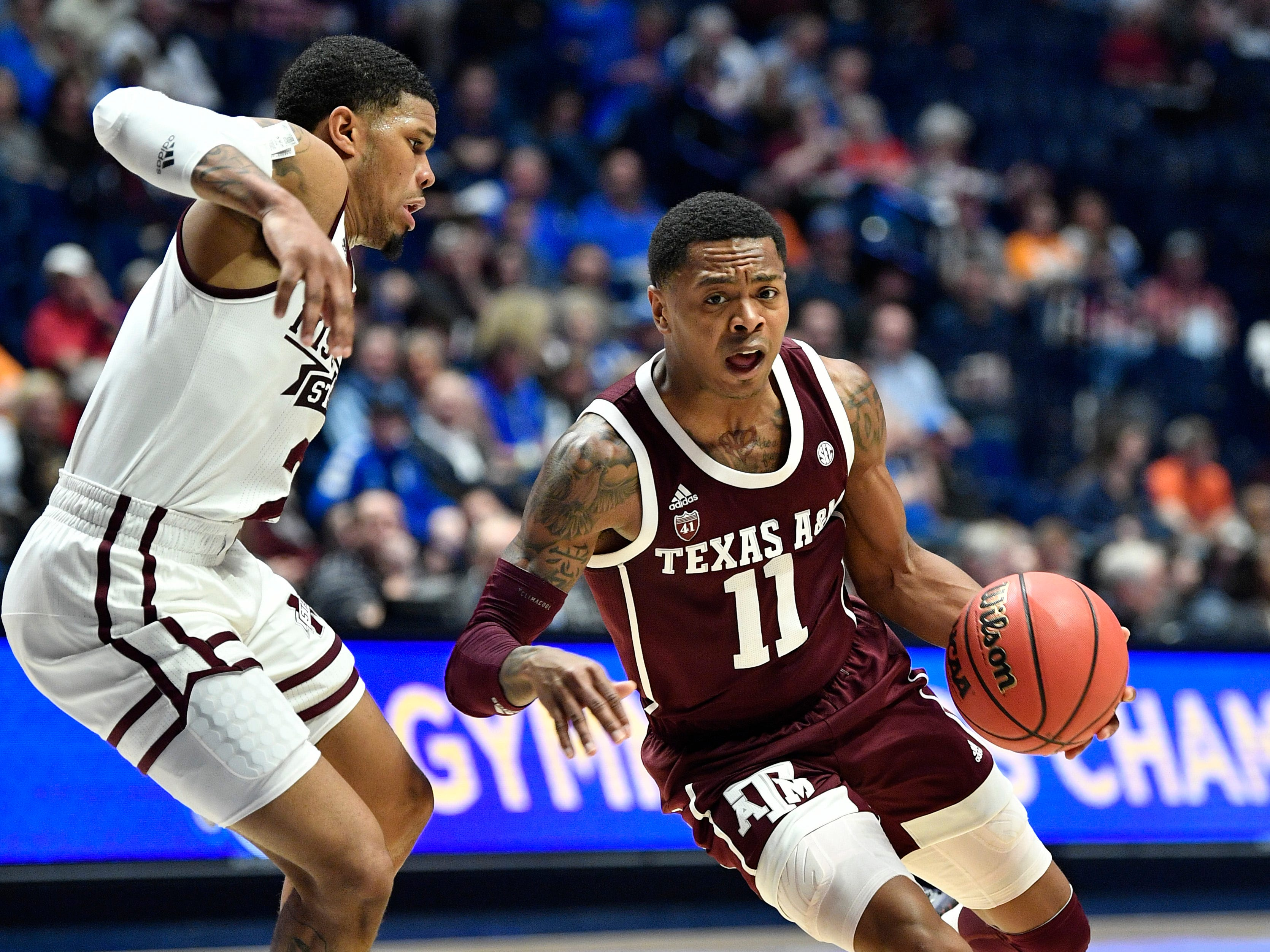 Texas A&M guard Wendell Mitchell (11) moves the ball defended by Mississippi State guard Lamar Peters (2) during the first half of the SEC Men's Basketball Tournament game at Bridgestone Arena in Nashville, Tenn., Thursday, March 14, 2019.