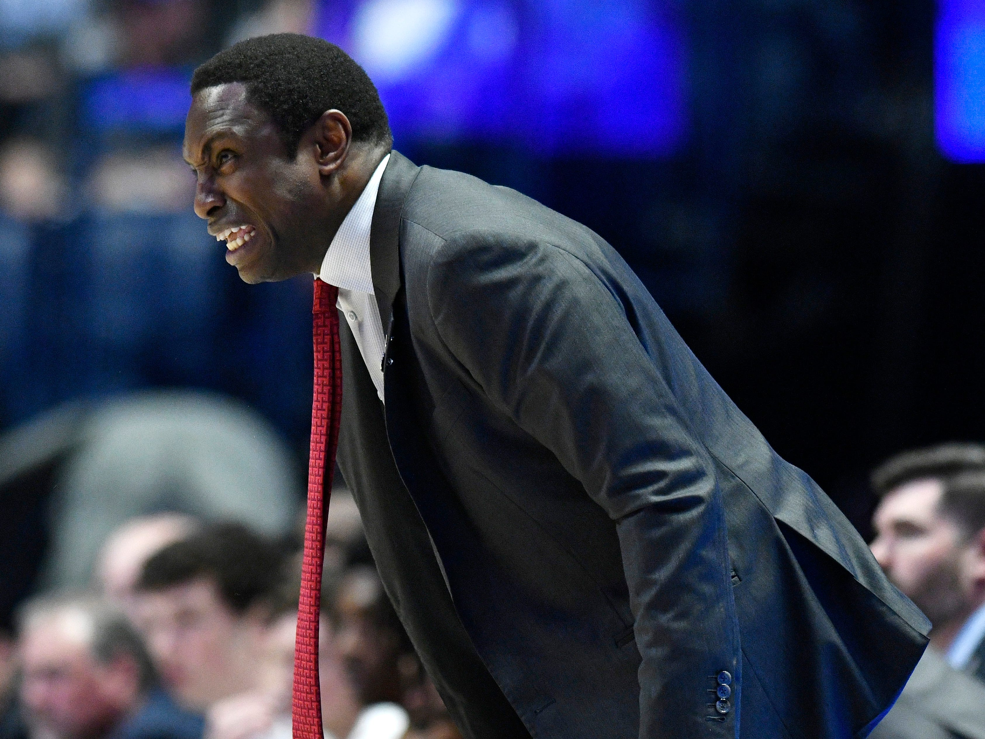 Alabama head coach Avery Johnson yells to his team during the second half of the SEC Men's Basketball Tournament game at Bridgestone Arena in Nashville, Tenn., Thursday, March 14, 2019.