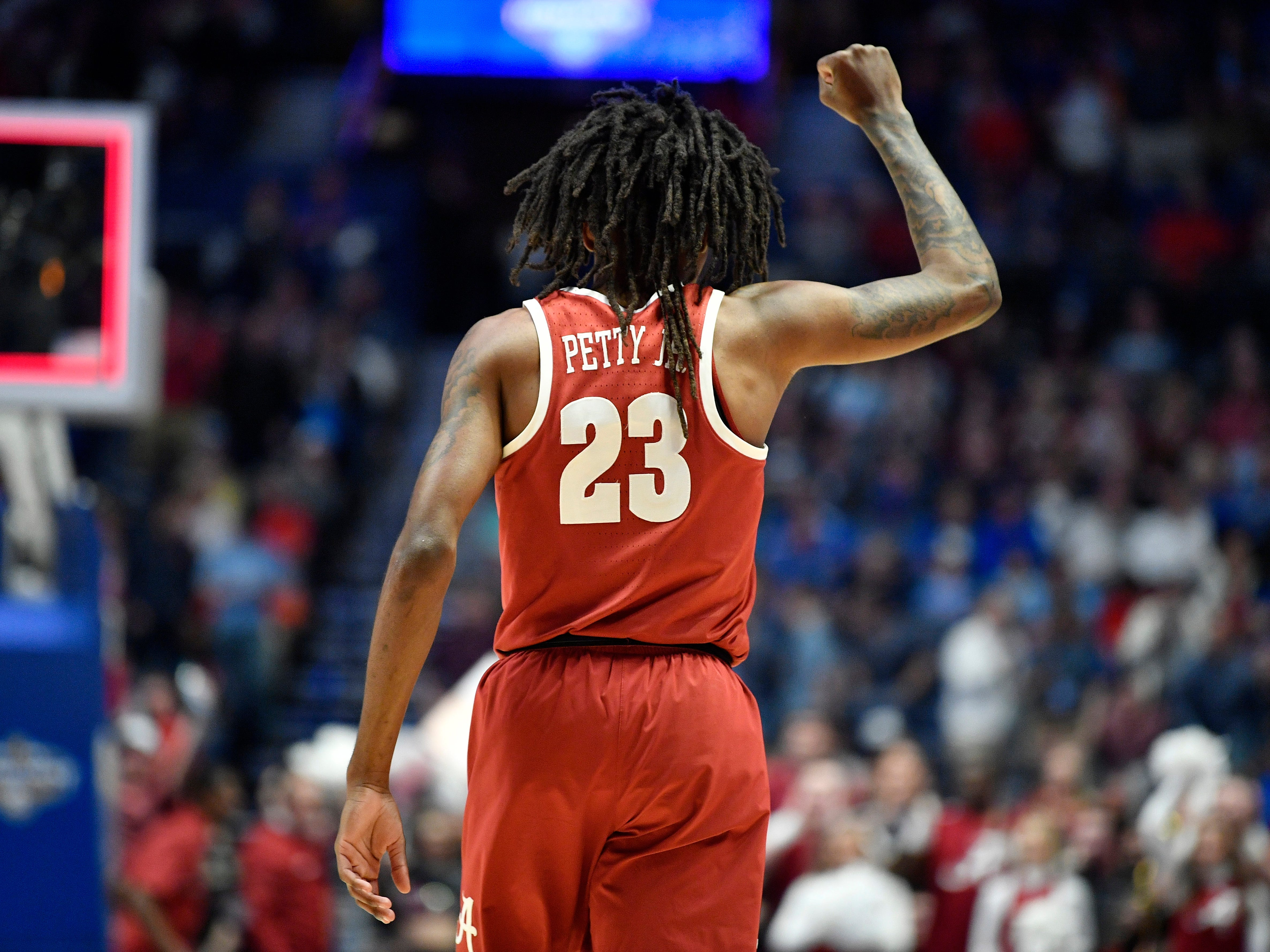 Alabama guard John Petty (23) celebrates in the closing minutes of the SEC Men's Basketball Tournament win over Ole Miss at Bridgestone Arena in Nashville, Tenn., Thursday, March 14, 2019.