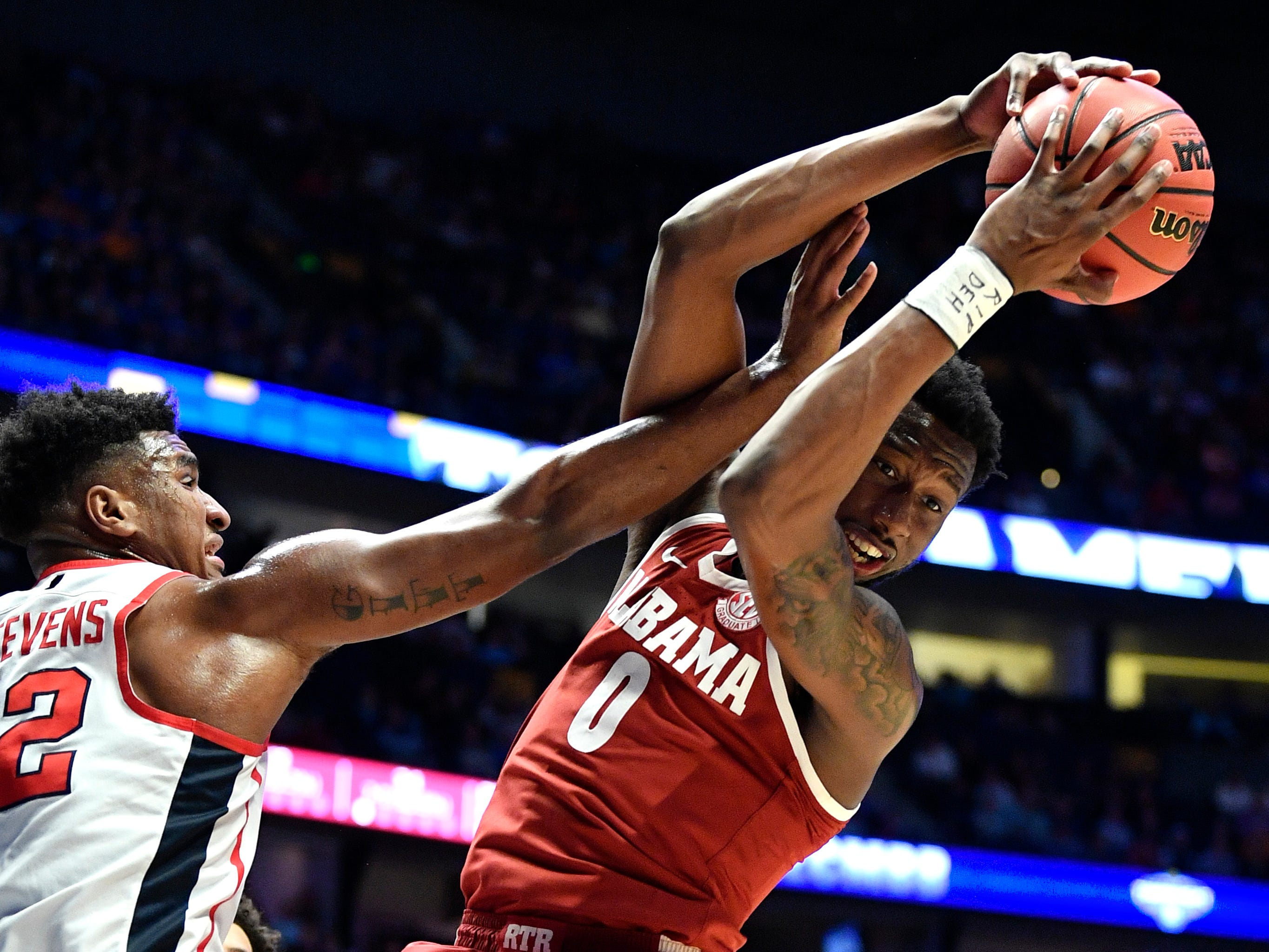 Alabama forward Donta Hall (0) comes down with a rebound defended by Ole Miss forward Bruce Stevens (12) during the second half of the SEC Men's Basketball Tournament game at Bridgestone Arena in Nashville, Tenn., Thursday, March 14, 2019.