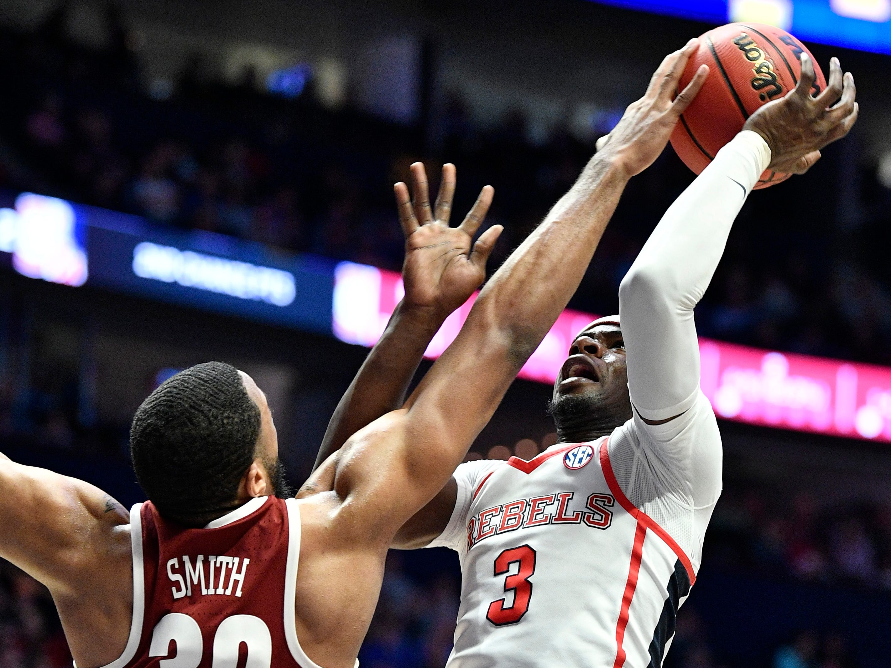 Alabama forward Galin Smith (30) strips the ball from Ole Miss guard Terence Davis (3) during the second half of the SEC Men's Basketball Tournament game at Bridgestone Arena in Nashville, Tenn., Thursday, March 14, 2019.