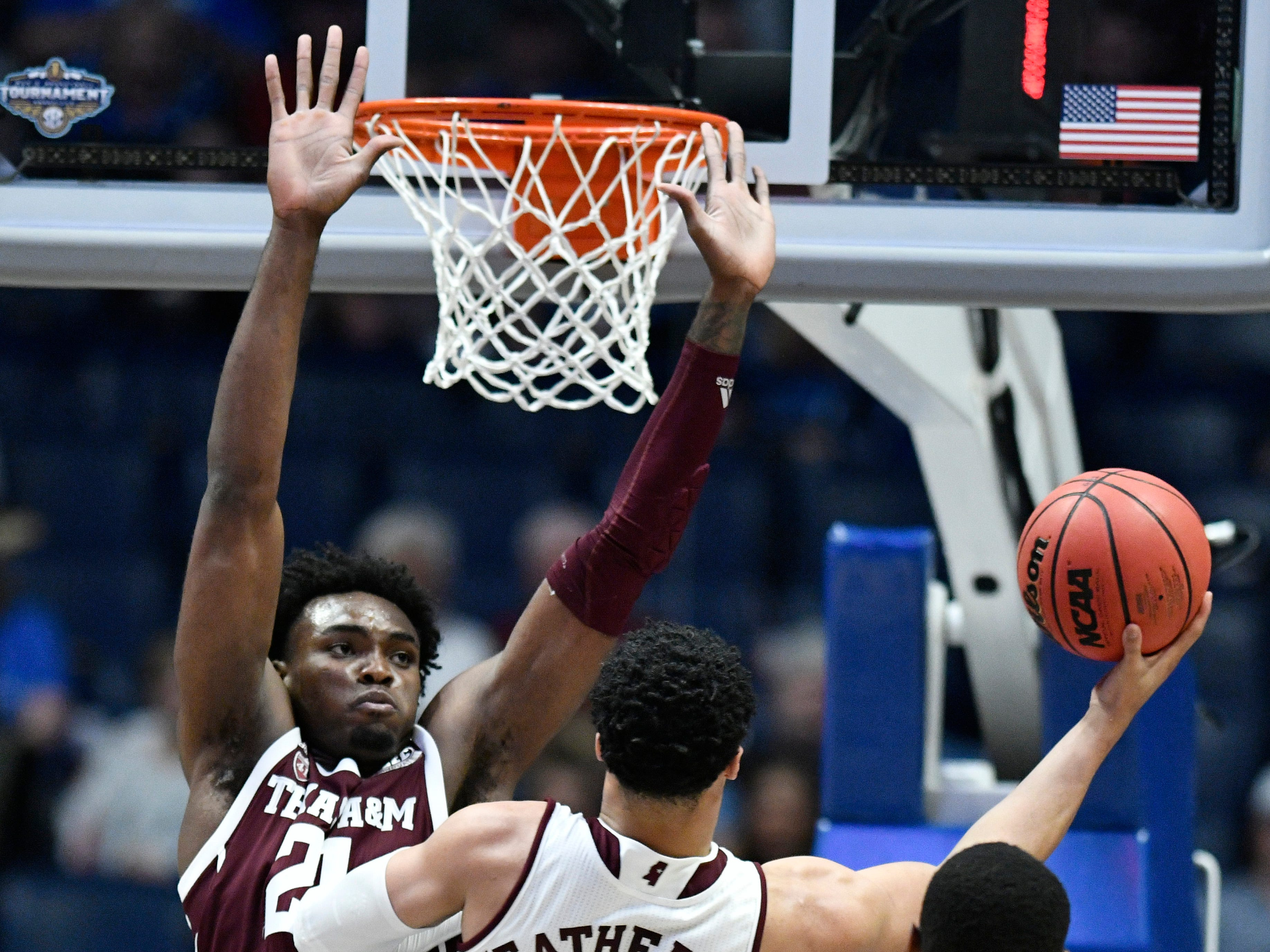 Mississippi State guard Quinndary Weatherspoon (11) shoots defended by Texas A&M forward Christian Mekowulu (21) during the first half of the SEC Men's Basketball Tournament game at Bridgestone Arena in Nashville, Tenn., Thursday, March 14, 2019.