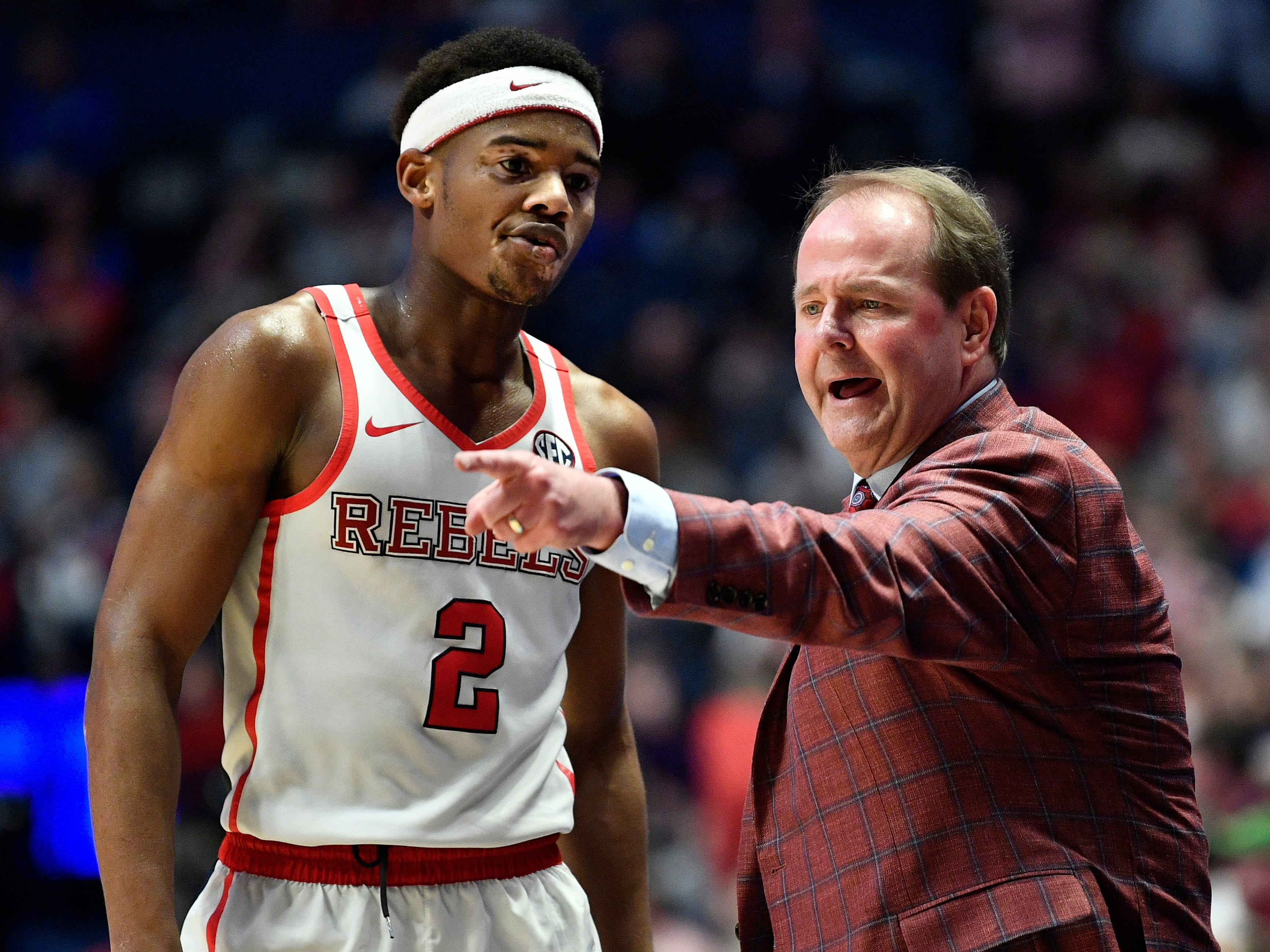 Ole Miss head coach Kermit Davis talks to guard Devontae Shuler (2) during the second half of the SEC Men's Basketball Tournament game at Bridgestone Arena in Nashville, Tenn., Thursday, March 14, 2019.