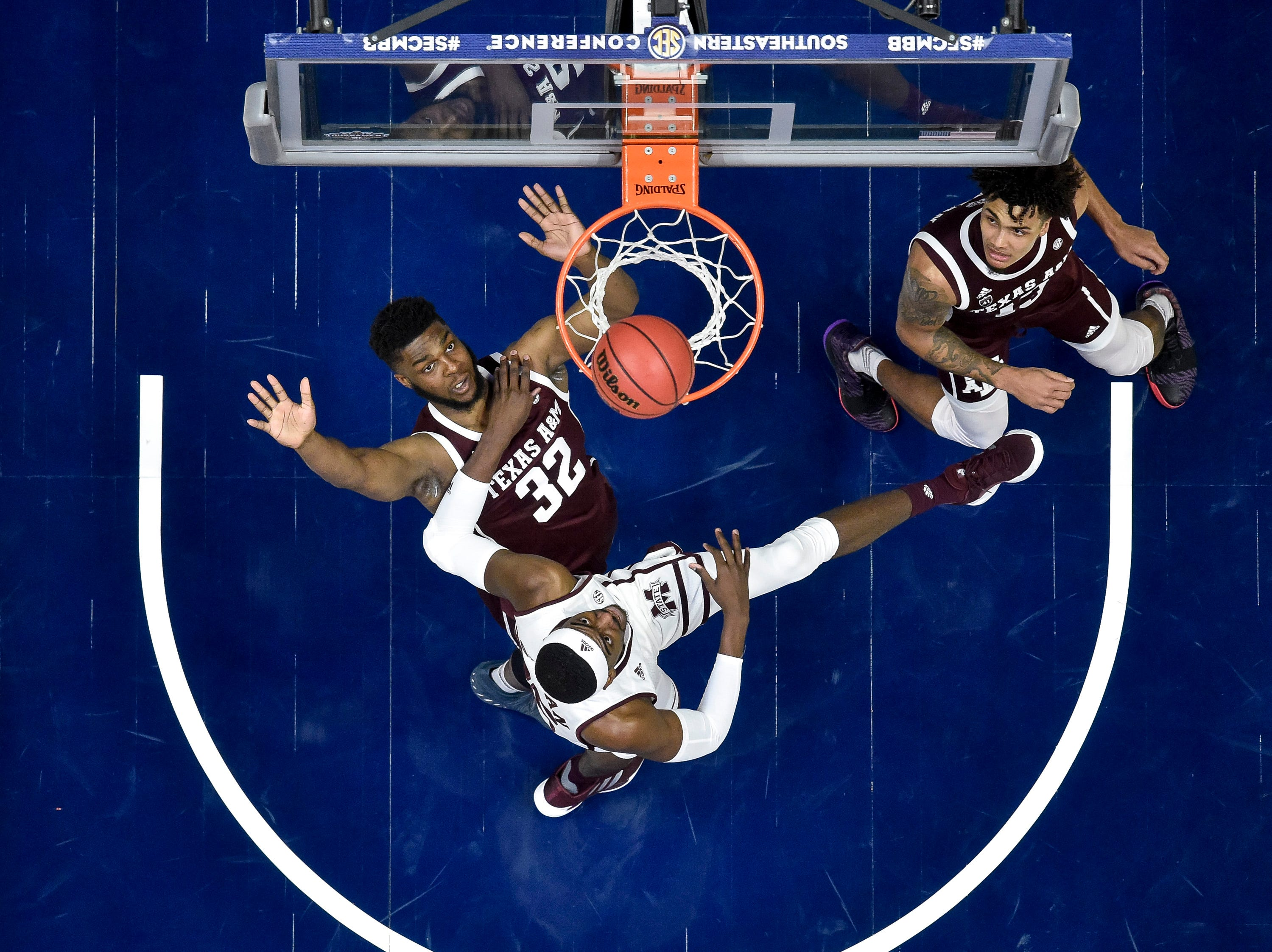 Mississippi State forward Aric Holman (35) shoots past Texas A&M forward Josh Nebo (32) during the first half of the SEC Men's Basketball Tournament game at Bridgestone Arena in Nashville, Tenn., Thursday, March 14, 2019.