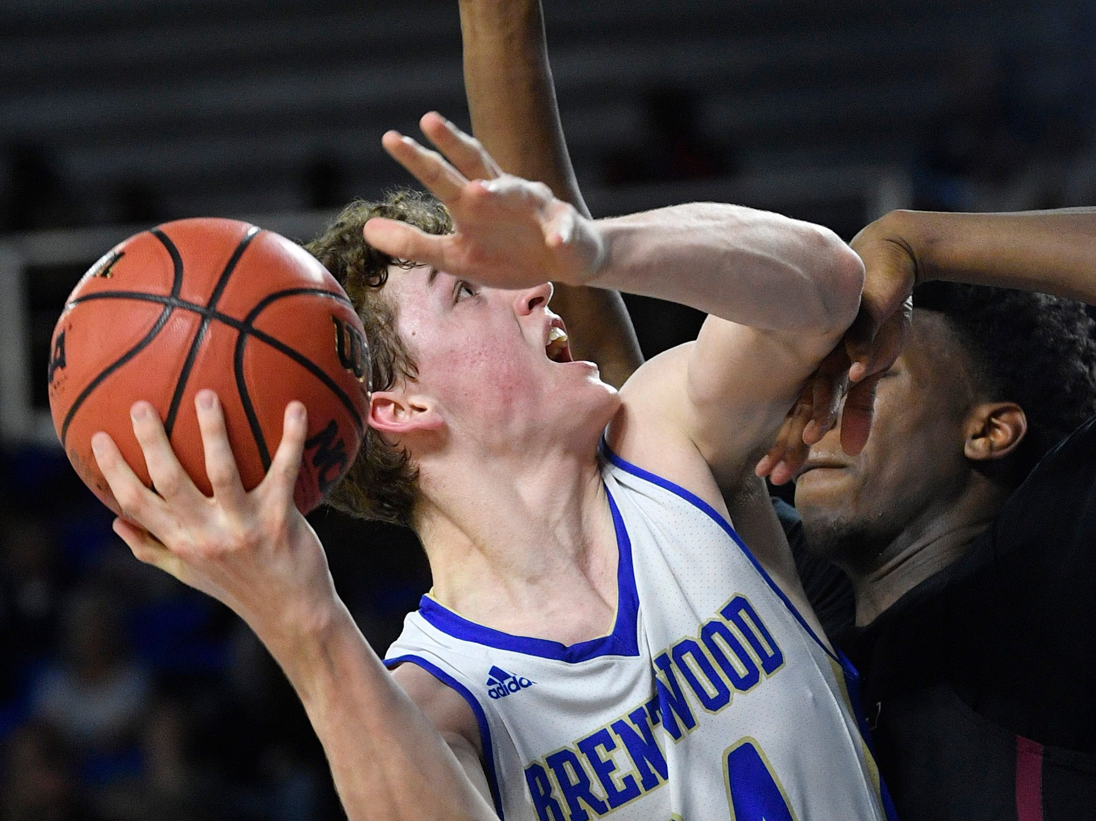 Brentwood's Ben Mills (34) tries to find an opening for a shot as Brentwood plays Memphis East in the TSSAA Class AAA semifinal  Friday, March 15, 2019, in Murfreesboro, Tenn.