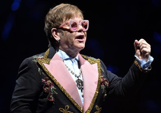Elton John performs at Bridgestone Arena Wednesday, Oct. 24, 2018, in Nashville, Tennessee. He wore the same navy-with-sequins tuxedo coat with pink lapels March 18, 2019, at Amway Arena in Orlando, a makeup concert after canceling his Nov. 27, 2018 concert because of an ear infection.