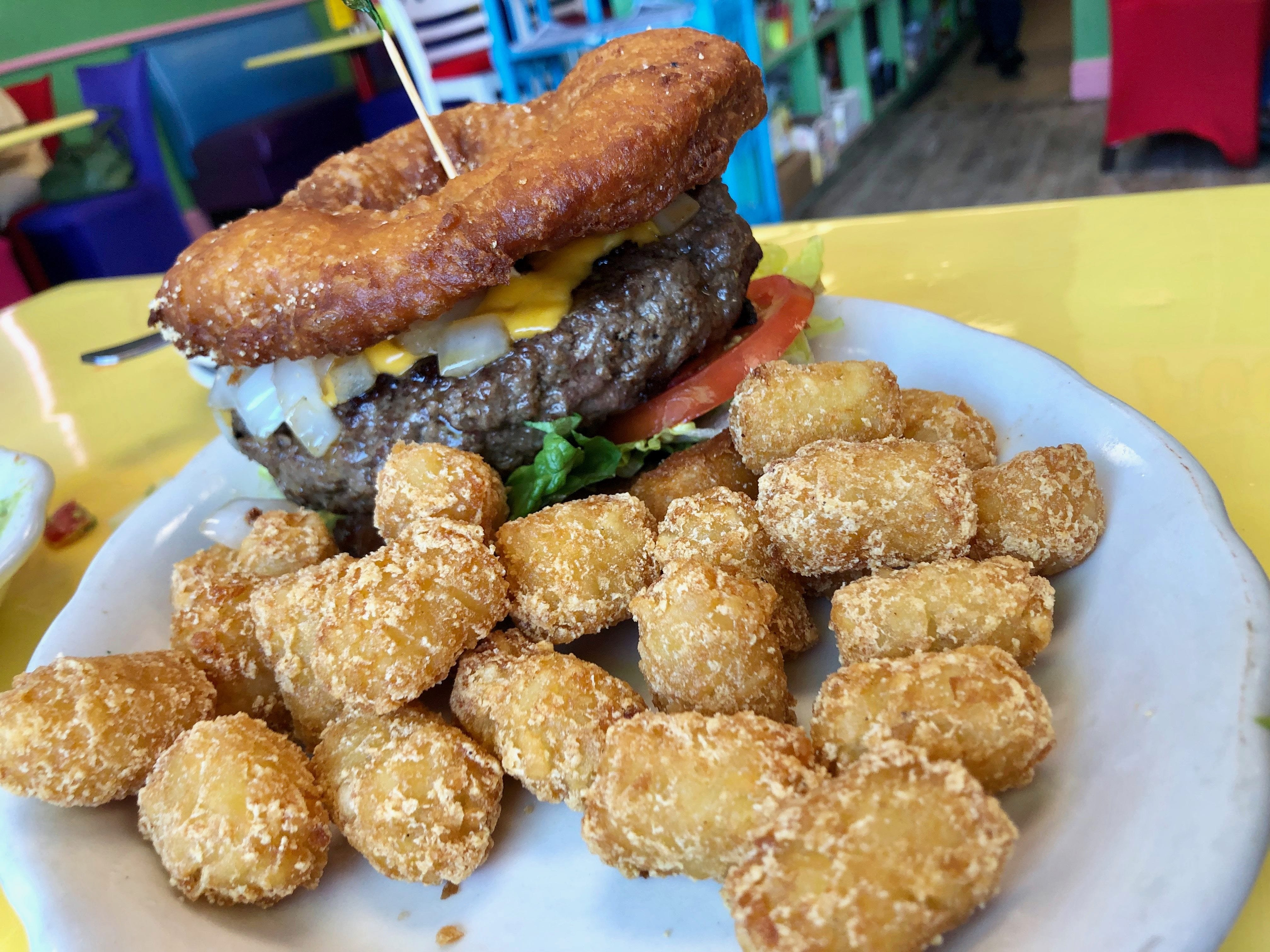 My burger at FK Your Diet came to the table unexpectedly sandwiched with deep-fried hamburger buns.