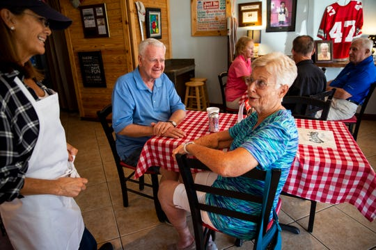 Jackie Chapin talks to Jan and Tony Pordon while her husband Greg Chapin sits down with Peggy and Cy Pick at Gatsby's Pizza in Bonita Springs on Thursday, March 14, 2019. Gatsby's has many regular customers, and one of the things that the Chapins like about their new, smaller space is that they're able to take the time to talk to everyone that comes in.