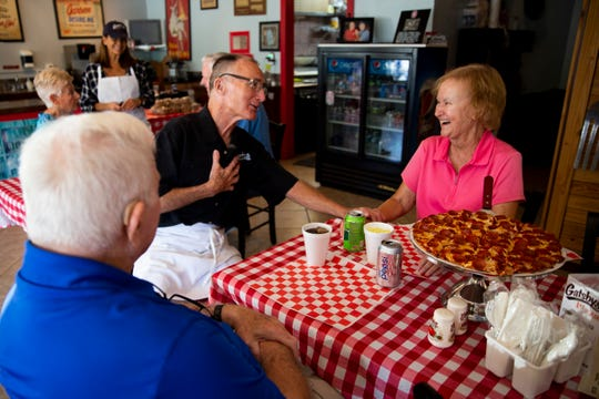 Greg Chapin sits down with Peggy and Cy Pick at Gatsby's Pizza in Bonita Springs on Thursday, March 14, 2019.