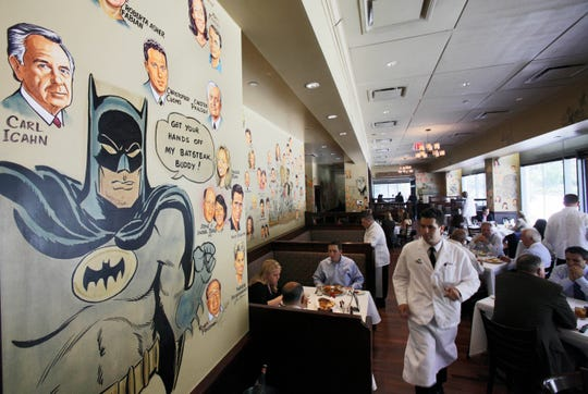 In this June 29, 2011 photo, caricatures adorn the walls of The Palm restaurant in New York's Tribeca neighborhood.