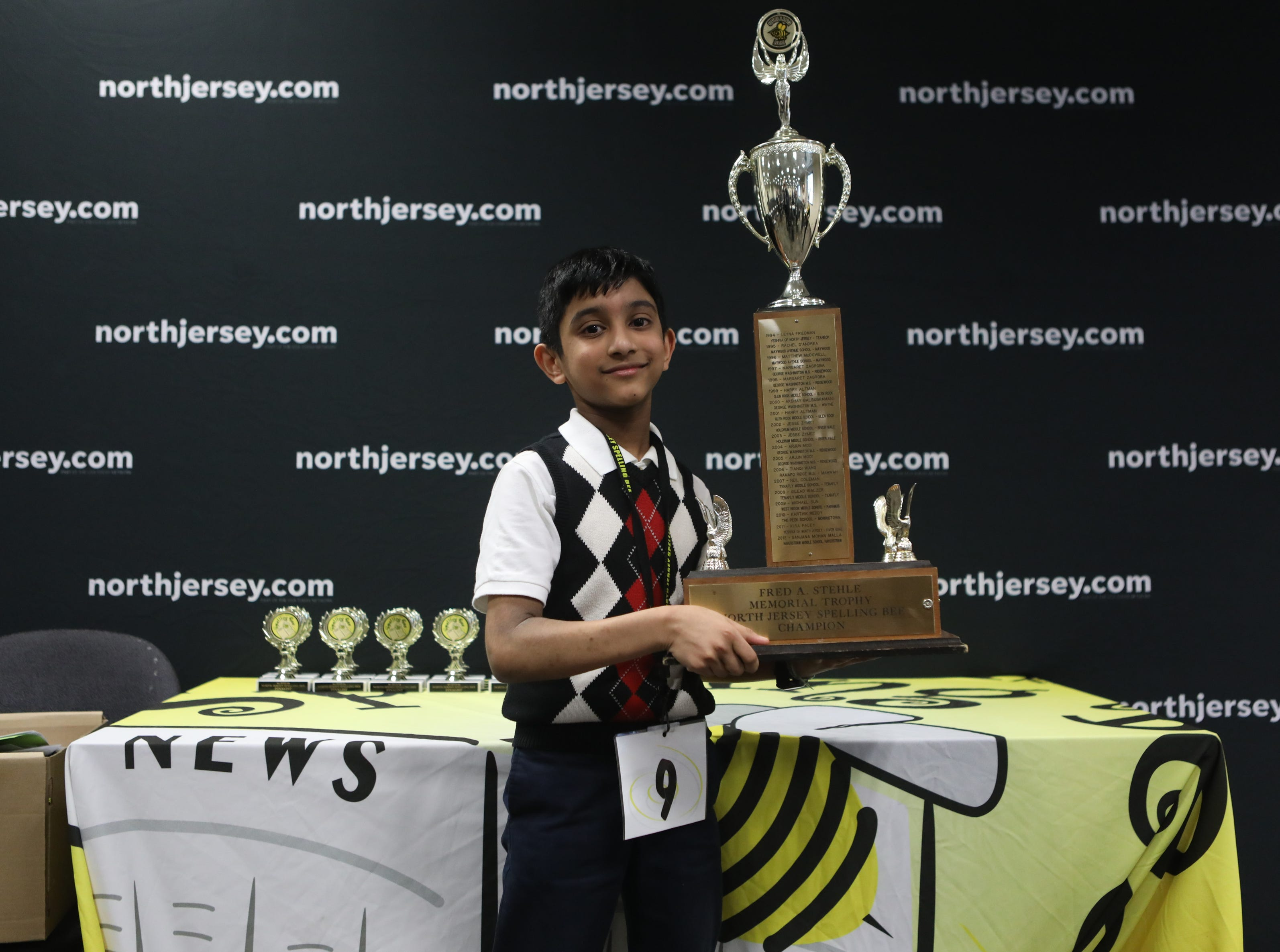 Jeremiah Markose poses with his trophy, after winning the spelling bee. Thursday, March 14, 2019