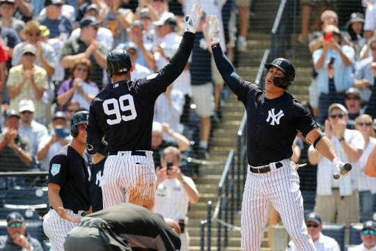 c2ed309d023 New York Yankees right fielder Aaron Judge (99) celebrates with left  fielder Giancarlo Stanton