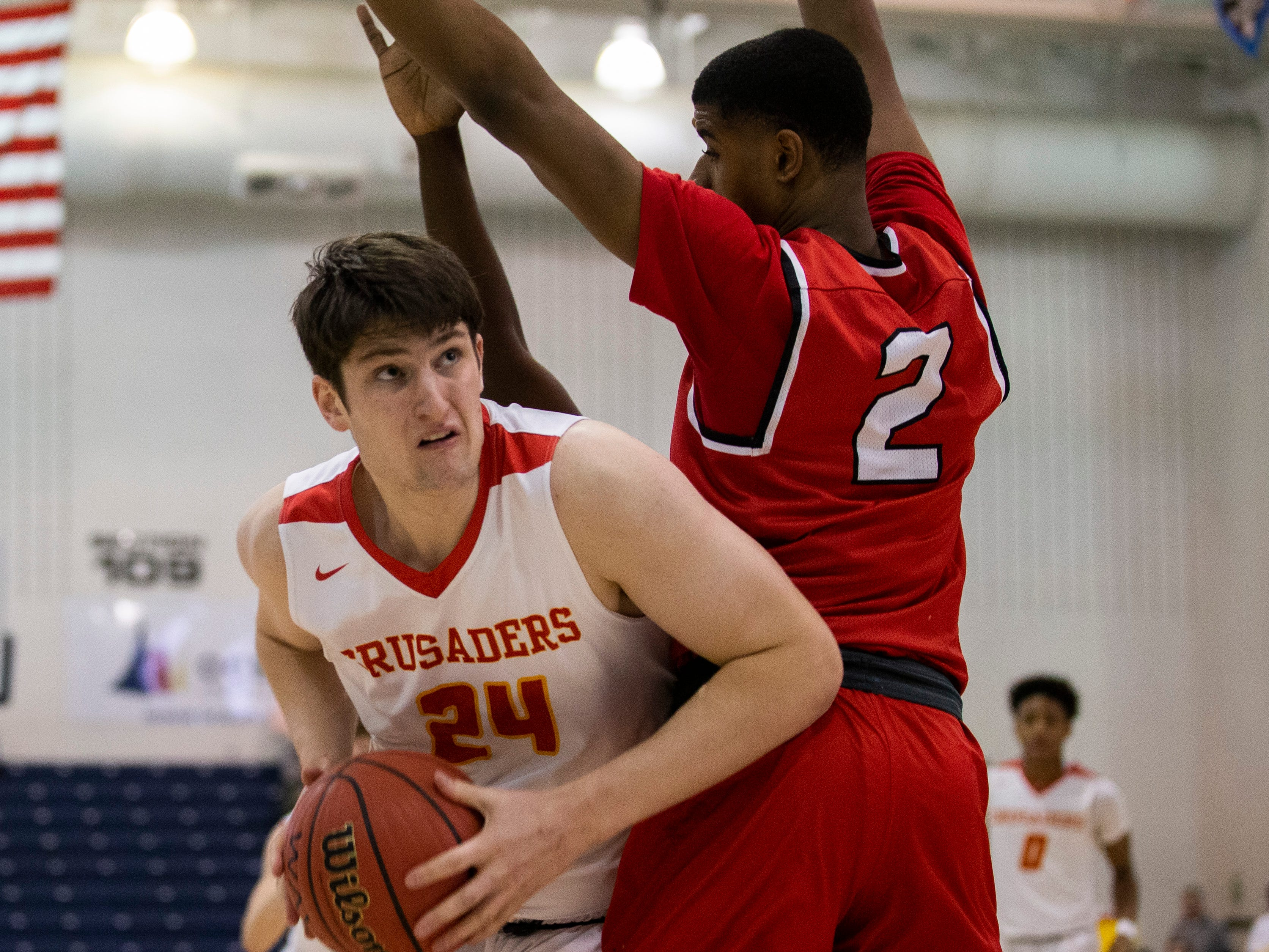 Matt Zona, Bergen Catholic looks low for an opening to the basket. Bergen Catholic vs. Newark East Side in the 5:30 p.m. semifinals of the 2019 NJSIAA Tournament of Champions in Toms River on March 15, 2019.