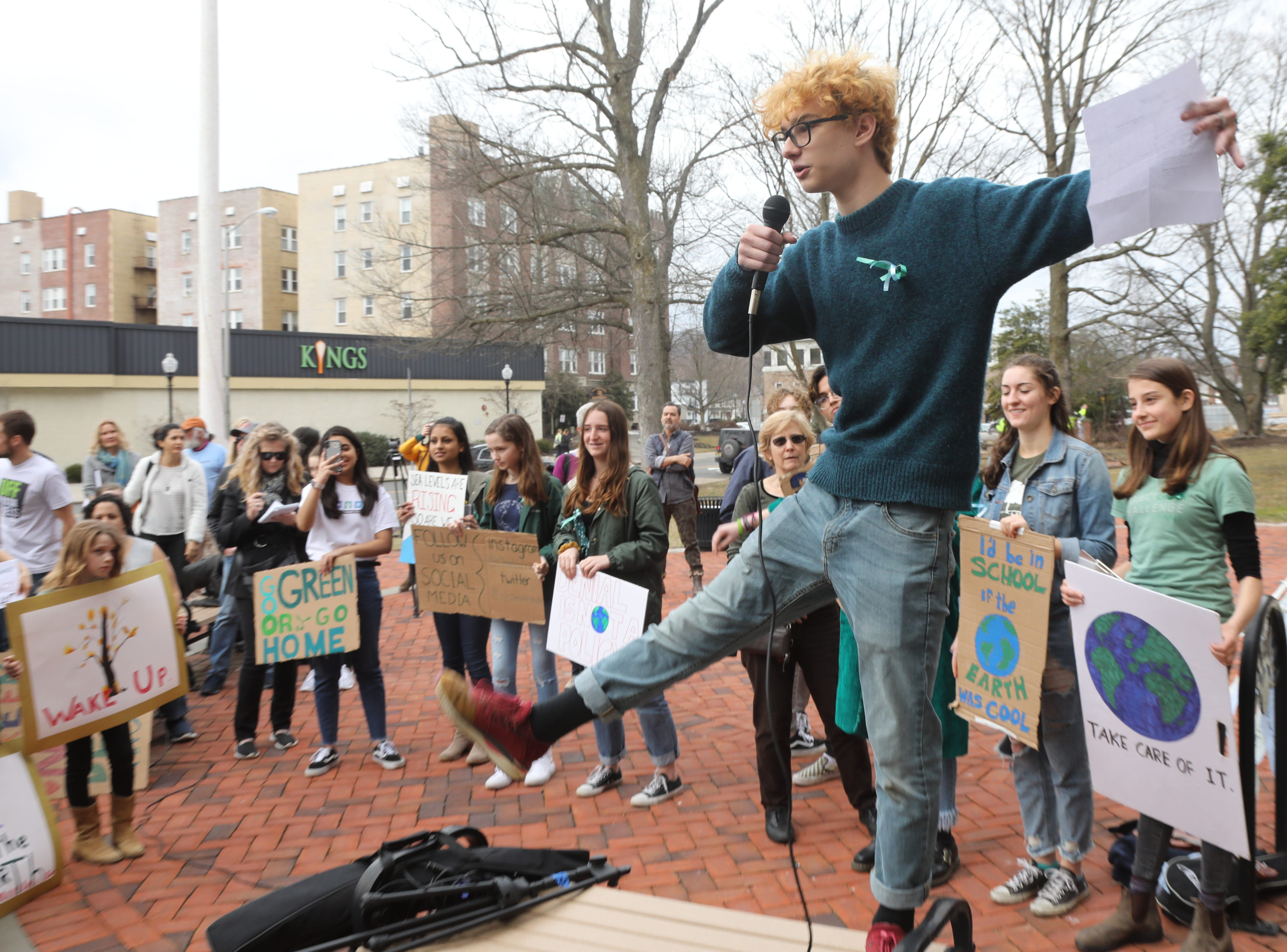 Nussy Andrews 17 of Long Valley and a student at the Morris County School of Technology tries to lose up the crowd as they prepared to chant their demands to address climate change.