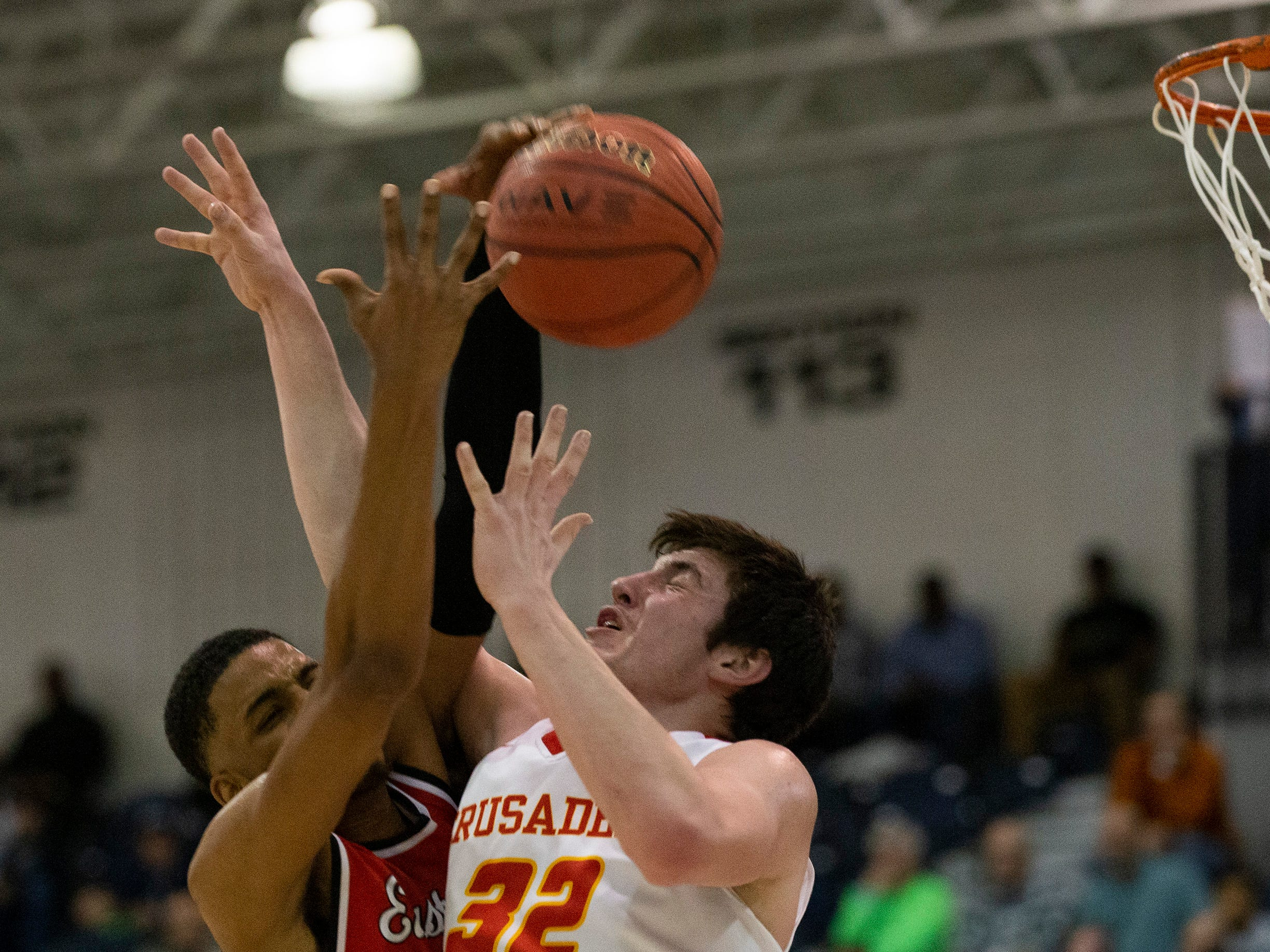 Mikah Johnson Jr. Eastside, goes after loose ball as does Bergen Catholic's Zachary Freemantle. Bergen Catholic vs. Newark East Side in the 5:30 p.m. semifinals of the 2019 NJSIAA Tournament of Champions in Toms River on March 15, 2019.