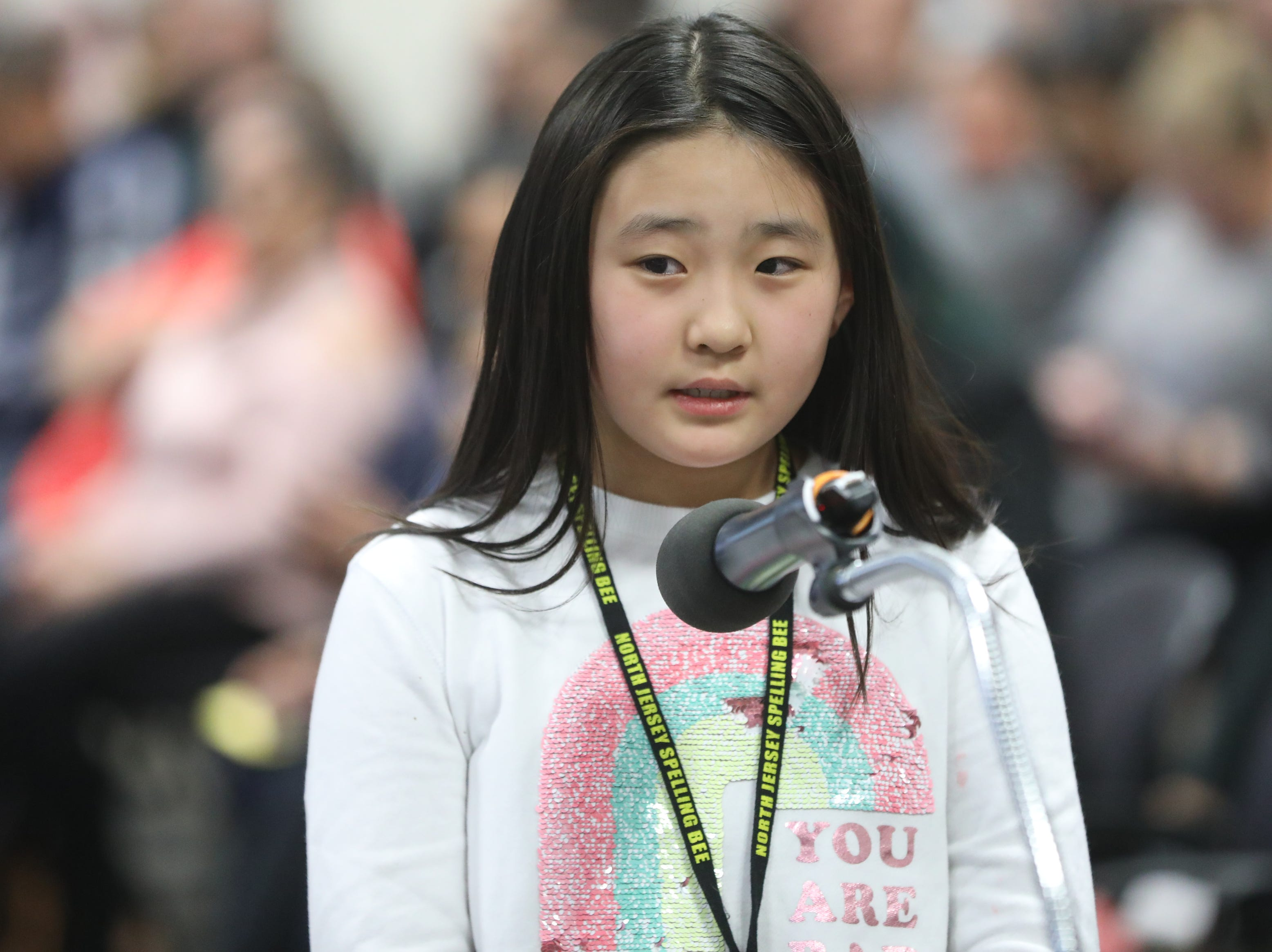 Gia Kim, of Paramus, competes in the first round of the 2019 North Jersey Spelling Bee, in Paramus. Thursday, March 14, 2019
