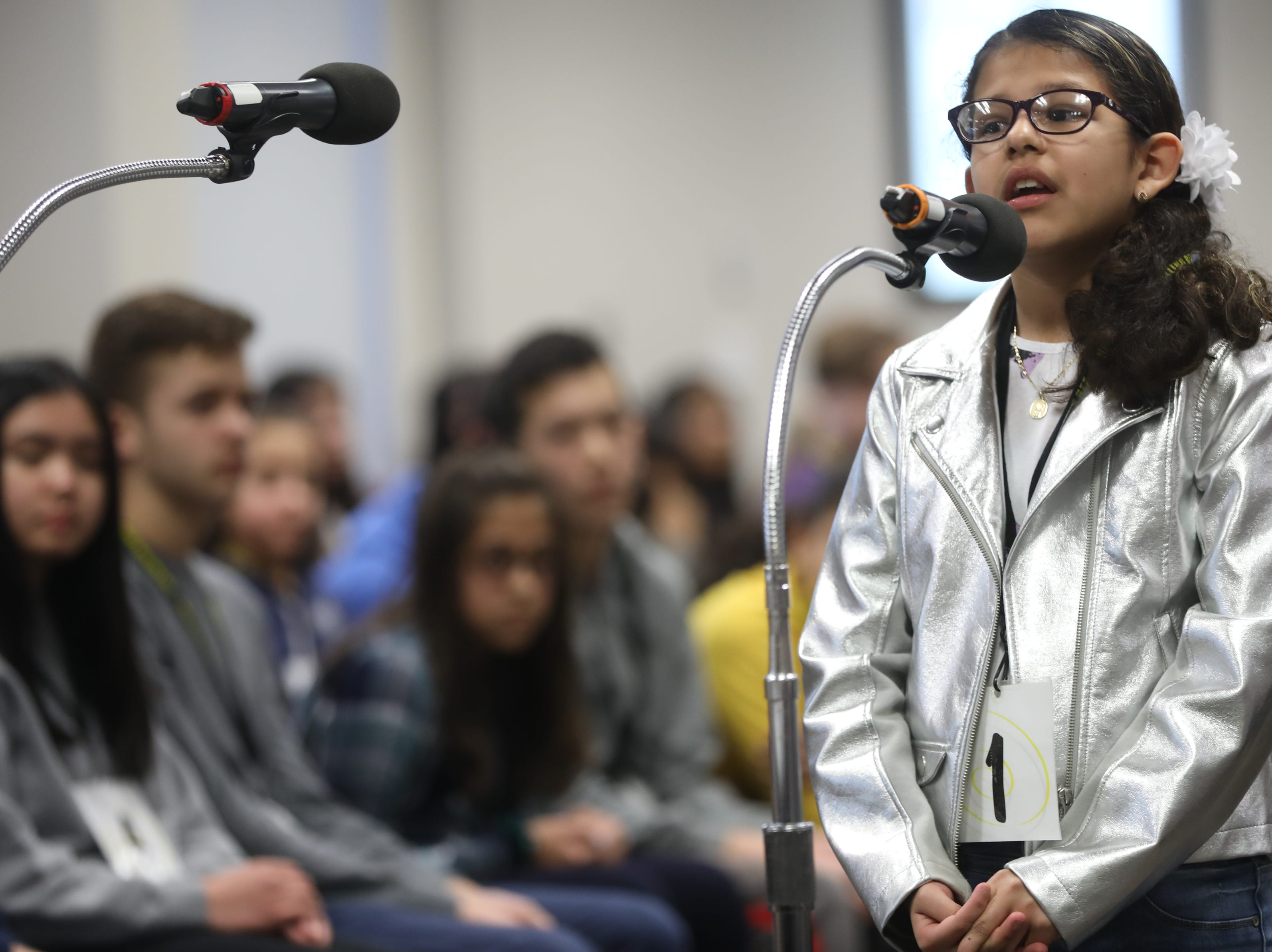 Melanie Flores, of Garfield, competes in the first round of the 2019 North Jersey Spelling Bee, in Paramus. Thursday, March 14, 2019