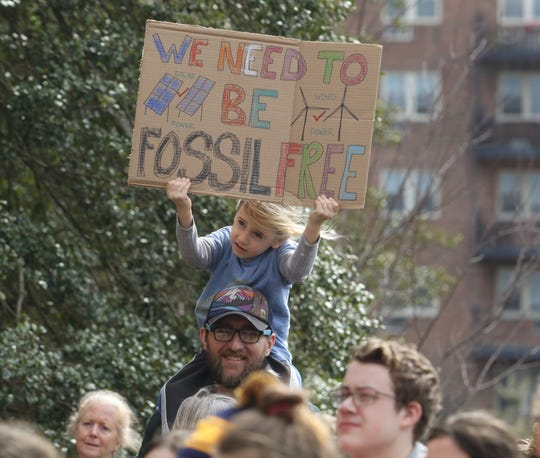 Sequoia Egan-Malone 5 of Sandyston is on the shoulders of his father Dan Egan as they listen to speakers addressing the need to stop climate change at a rally in March