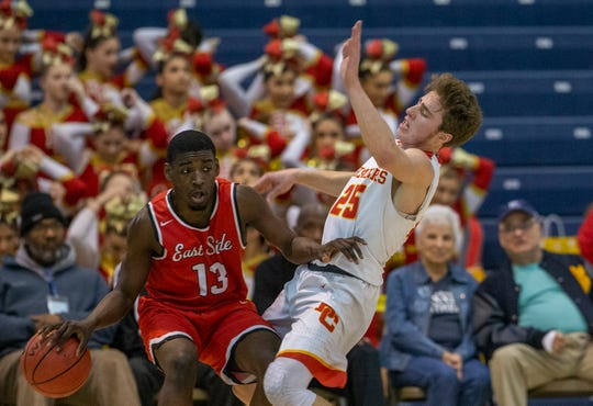 Doug Edert, Bergen Catholic takes a shove from East Side's Nasir Johnson. Bergen Catholic vs. Newark East Side in the 5:30 p.m. semifinals of the 2019 NJSIAA Tournament of Champions in Toms River on March 15, 2019.