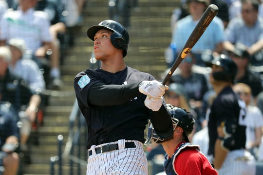 New York Yankees right fielder Aaron Judge (99) hits a three run home run during the second inning against the Boston Red Sox at George M. Steinbrenner Field.