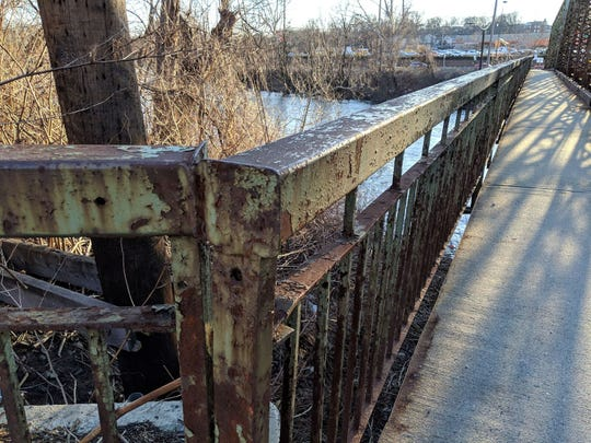 The railing next to the Fair Lawn Avenue Bridge has aged since it was built in 1905.