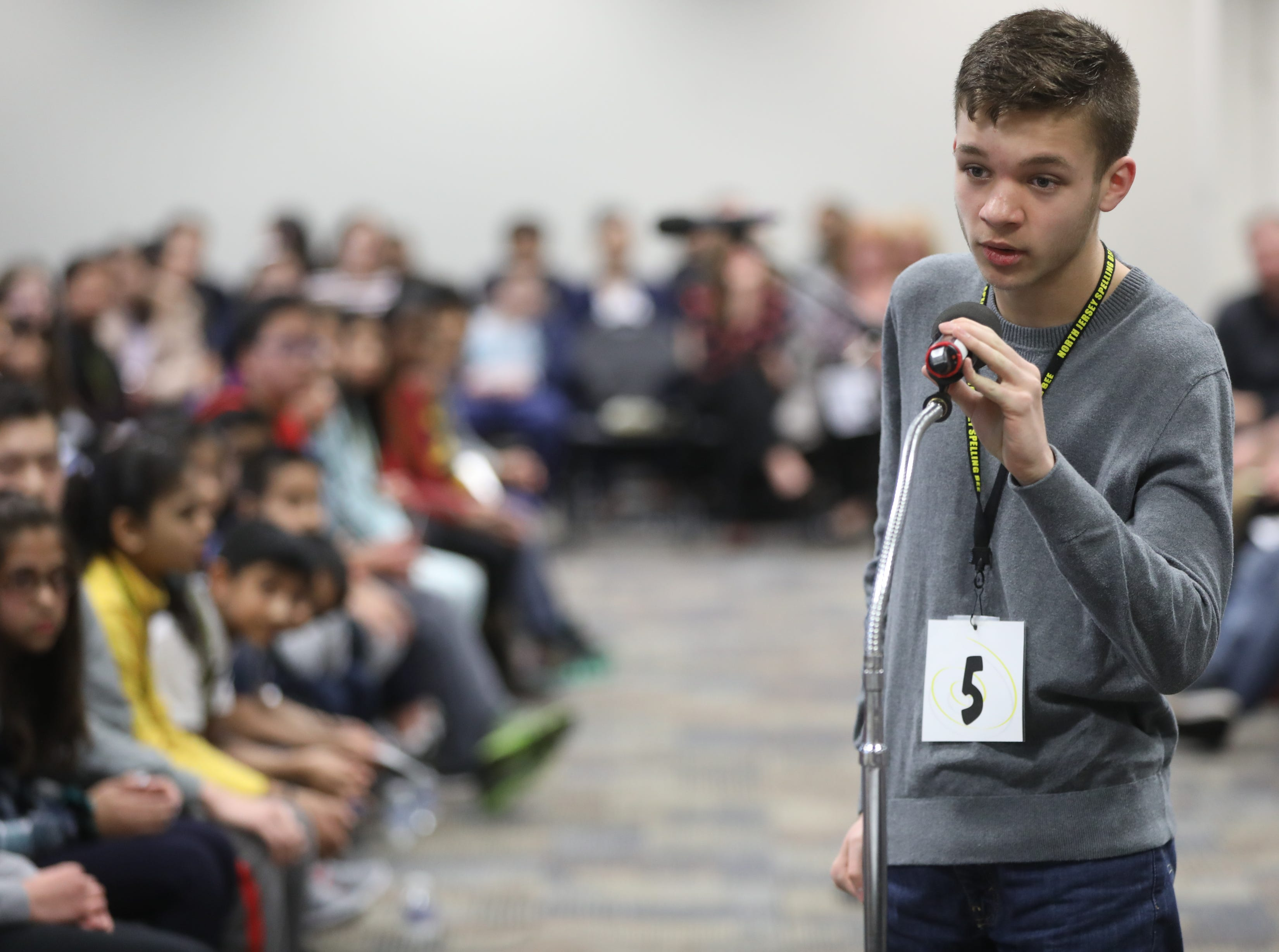 Damon Foster, of East Rutherford, competes in the first round of the 2019 North Jersey Spelling Bee, in Paramus. Thursday, March 14, 2019