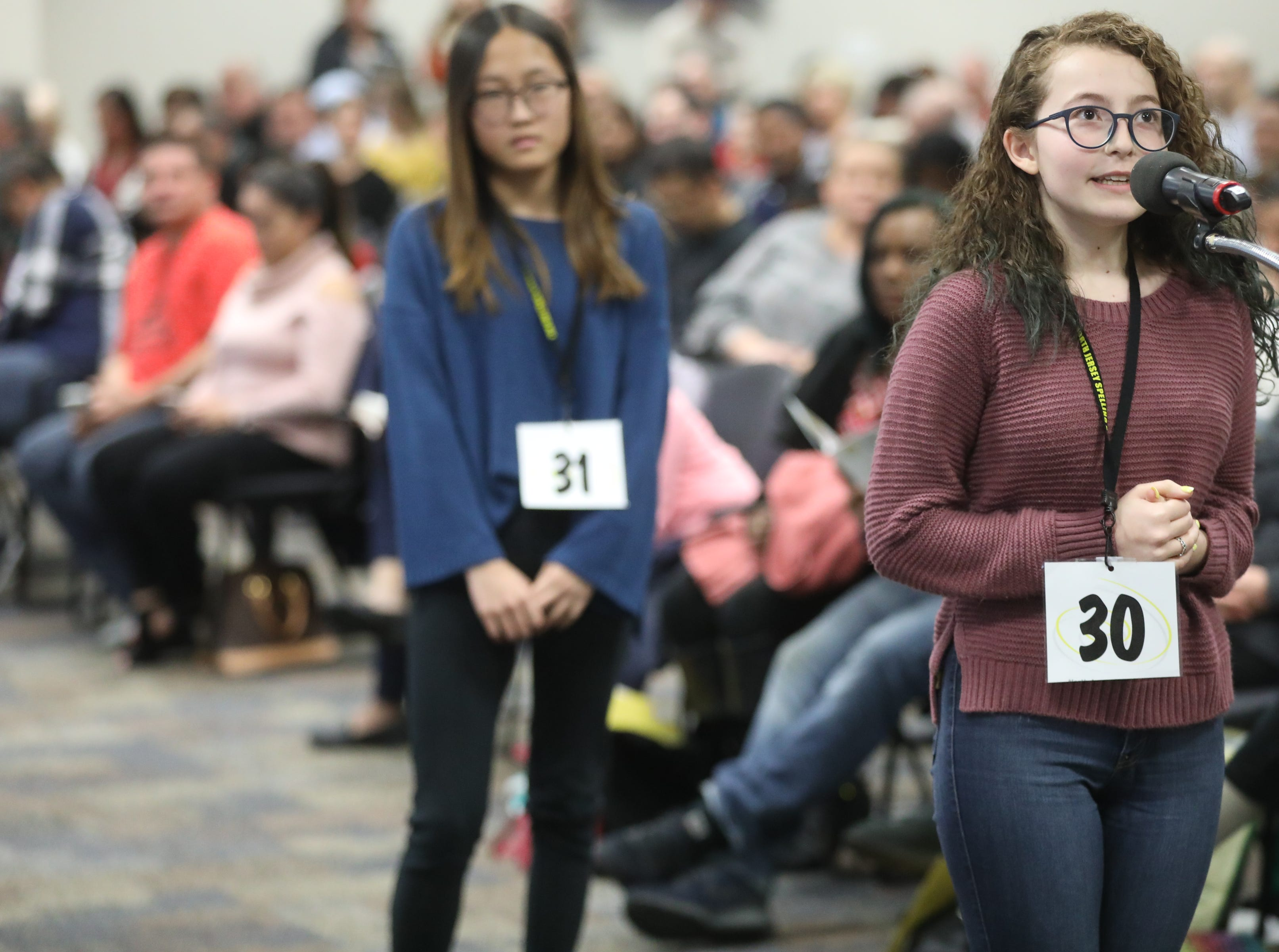 Mila Kush, of Haledon, competes in the first round of the 2019 North Jersey Spelling Bee, in Paramus. Thursday, March 14, 2019