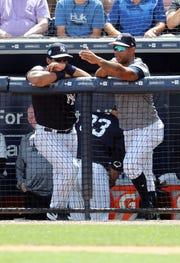 Mar 15, 2019; Tampa, FL, USA; New York Yankees center fielder Aaron Hicks (31) talks with guest player Russell Wilson  (73) at George M. Steinbrenner Field.