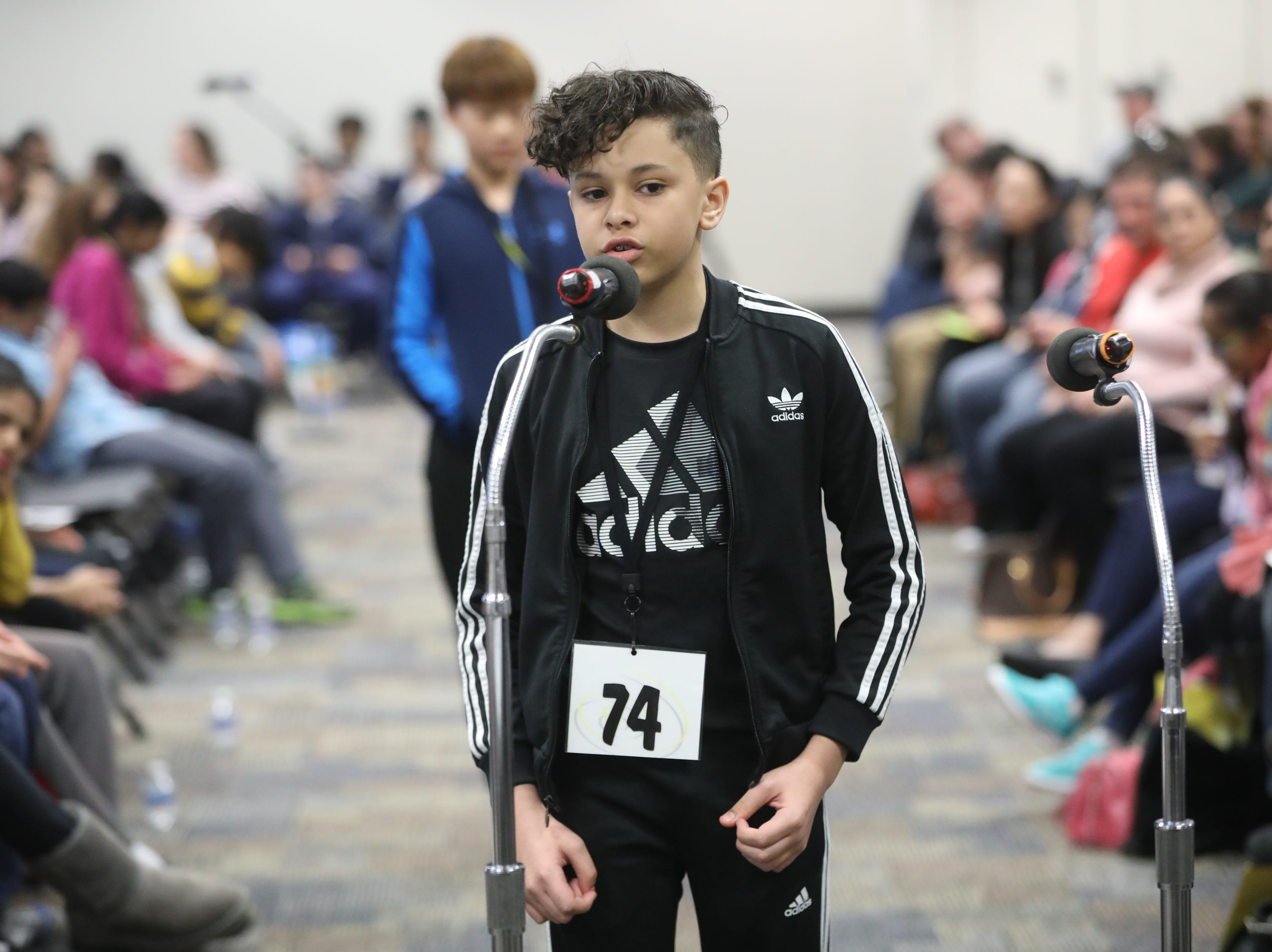 Socrates Luciano, of Fort Lee, competes in the first round of the 2019 North Jersey Spelling Bee, in Paramus. Thursday, March 14, 2019