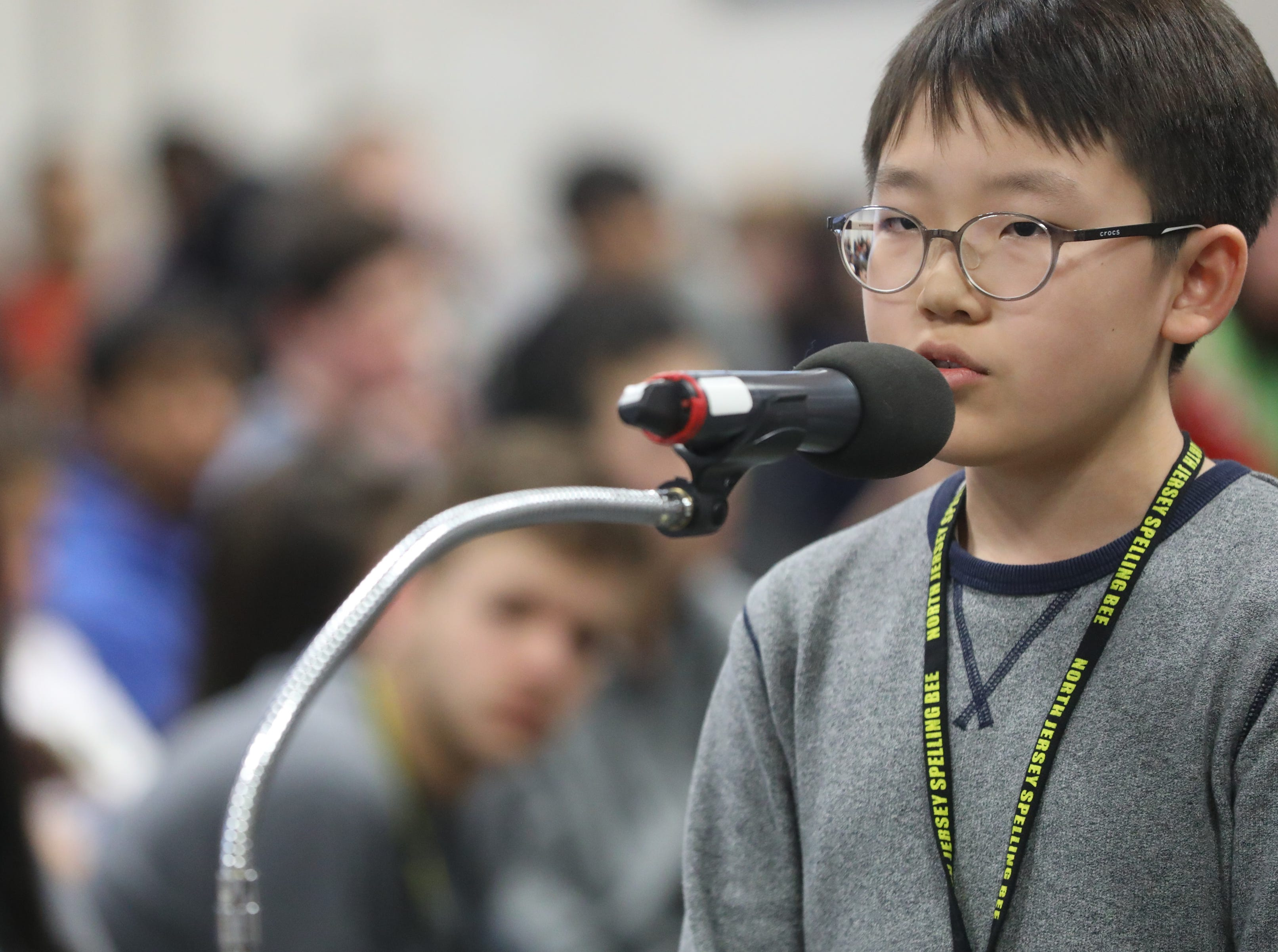 Jeremy Min, of Fort Lee, competes in the first round of the 2019 North Jersey Spelling Bee, in Paramus. Thursday, March 14, 2019