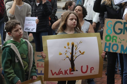 Groups of students in front of the Morristown Municipal Building on March 15, 2019 to express their demands to address climate change.