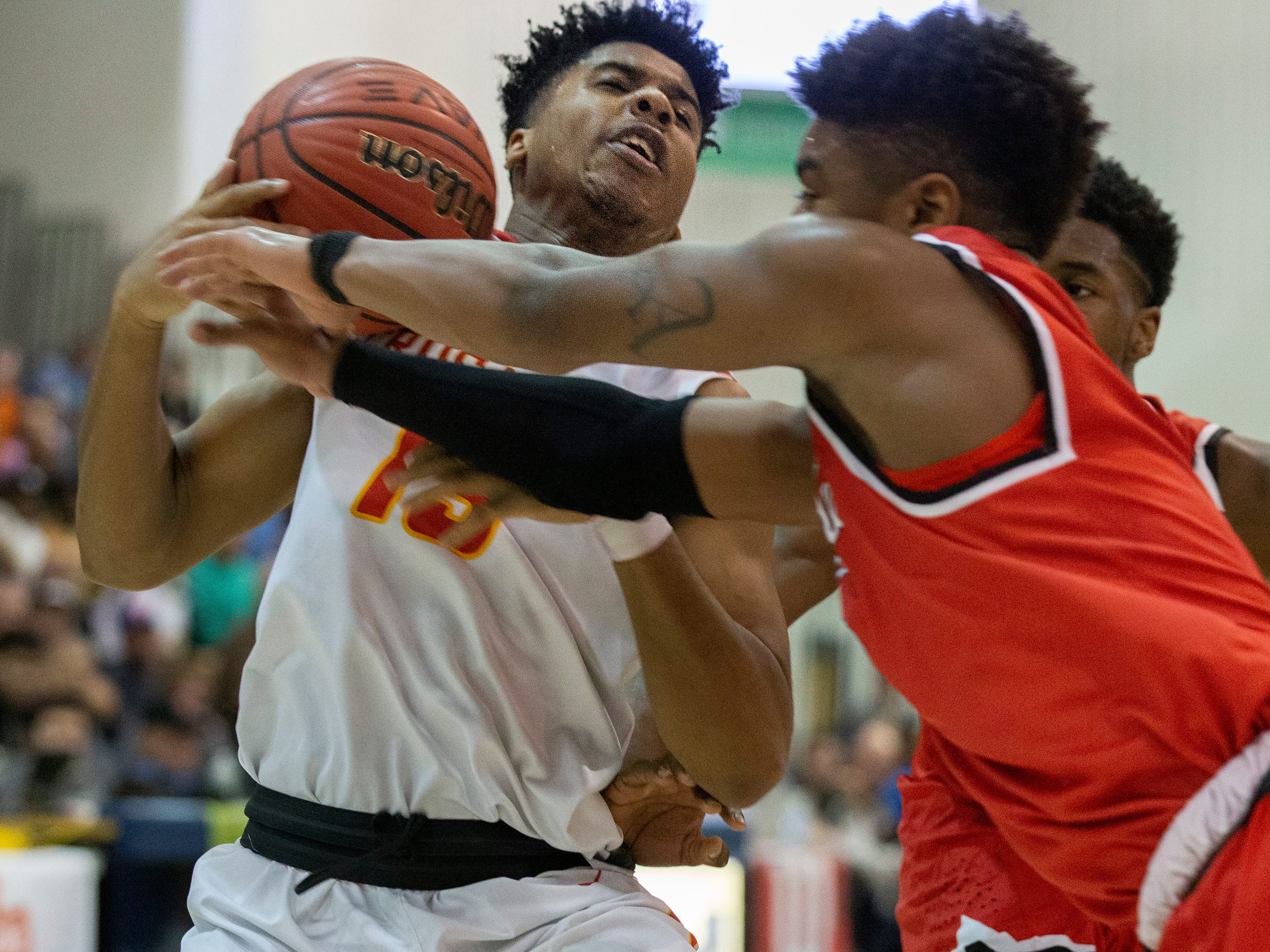 Bergen Catholic's Raejon Figures hits traffic as he works under the basket. Bergen Catholic vs. Newark East Side in the 5:30 p.m. semifinals of the 2019 NJSIAA Tournament of Champions in Toms River on March 15, 2019.