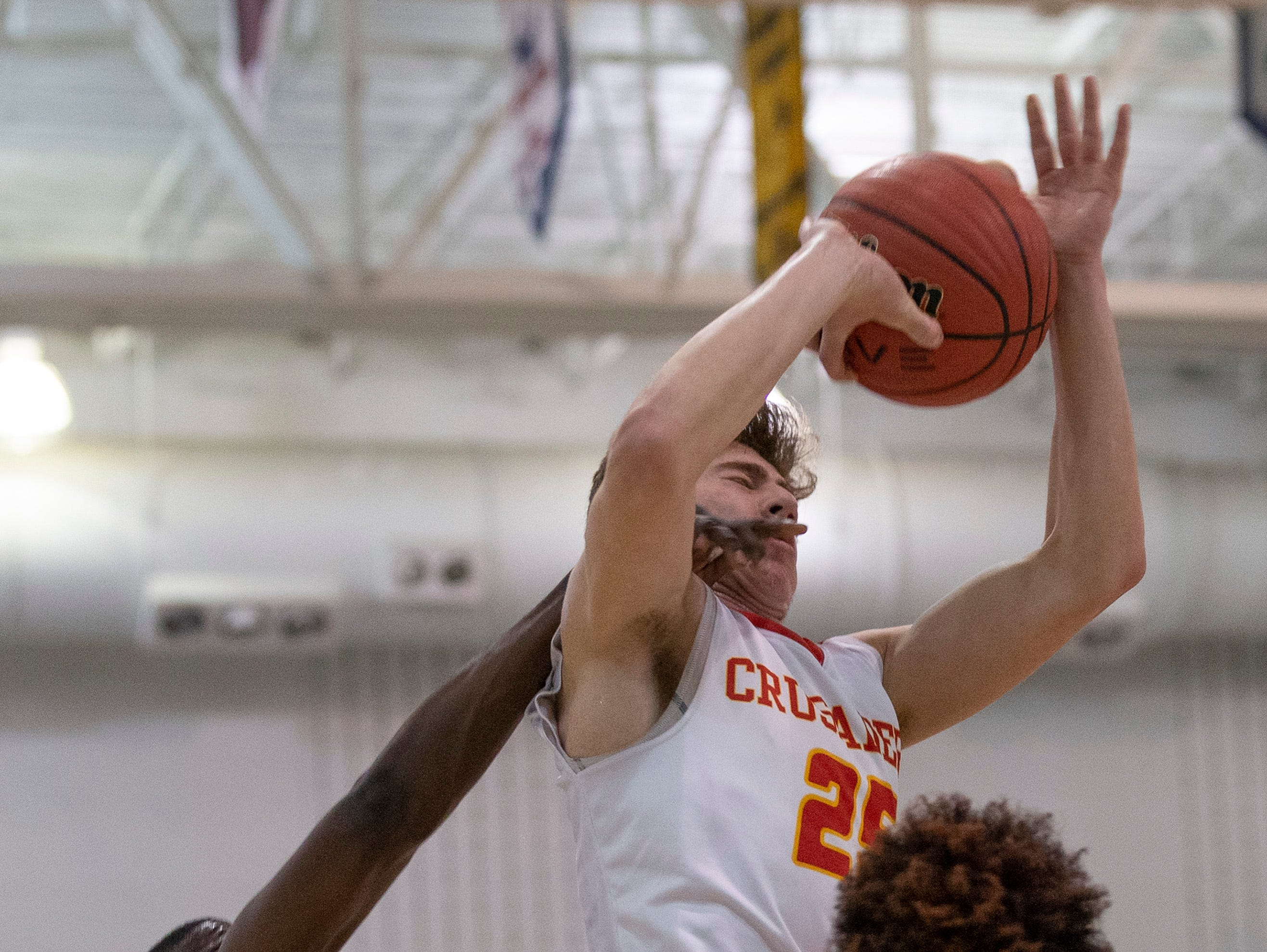 East Side's Nasir Johnson hits Bergen Catholic's Doug Edert as he goes up with a shot. Bergen Catholic vs. Newark East Side in the 5:30 p.m. semifinals of the 2019 NJSIAA Tournament of Champions in Toms River on March 15, 2019.
