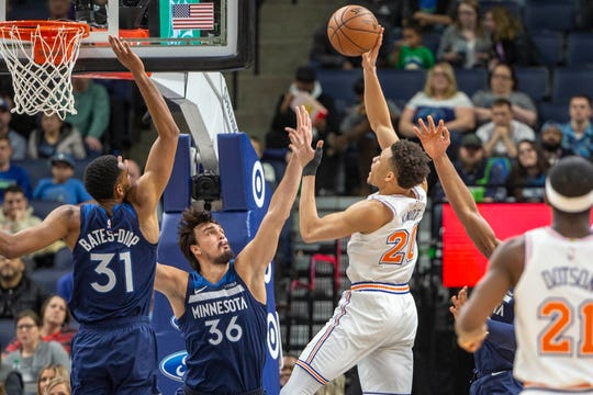 Mar 10, 2019; Minneapolis, MN, USA; New York Knicks forward Kevin Knox (20) shoots the ball over Minnesota Timberwolves forward Dario Saric (36) in the second half at Target Center.