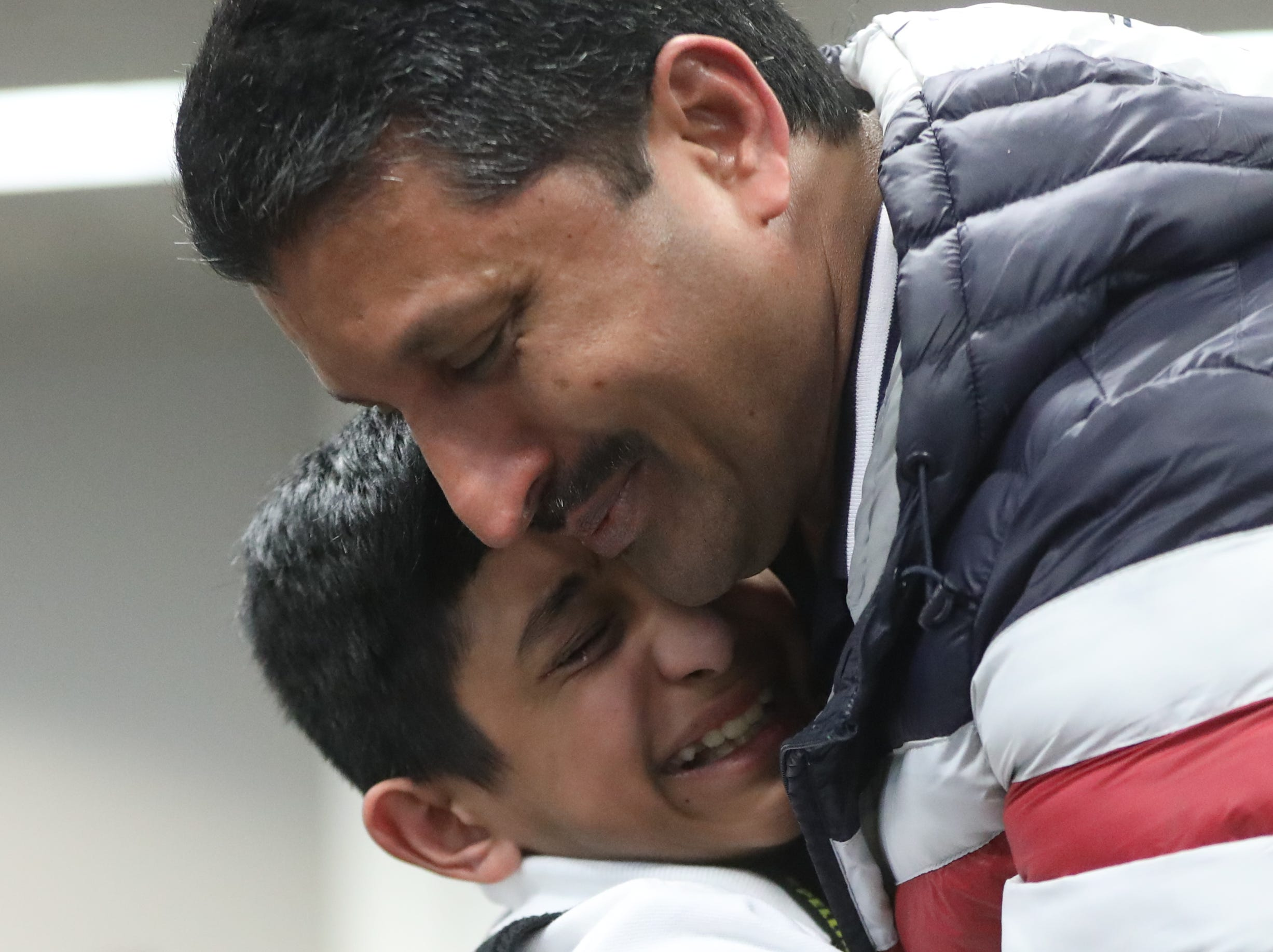 Spelling bee champion, Jeremiah Markose sheds tears of joy as he hugs his dad, Regimon Markose. Thursday, March 14, 2019