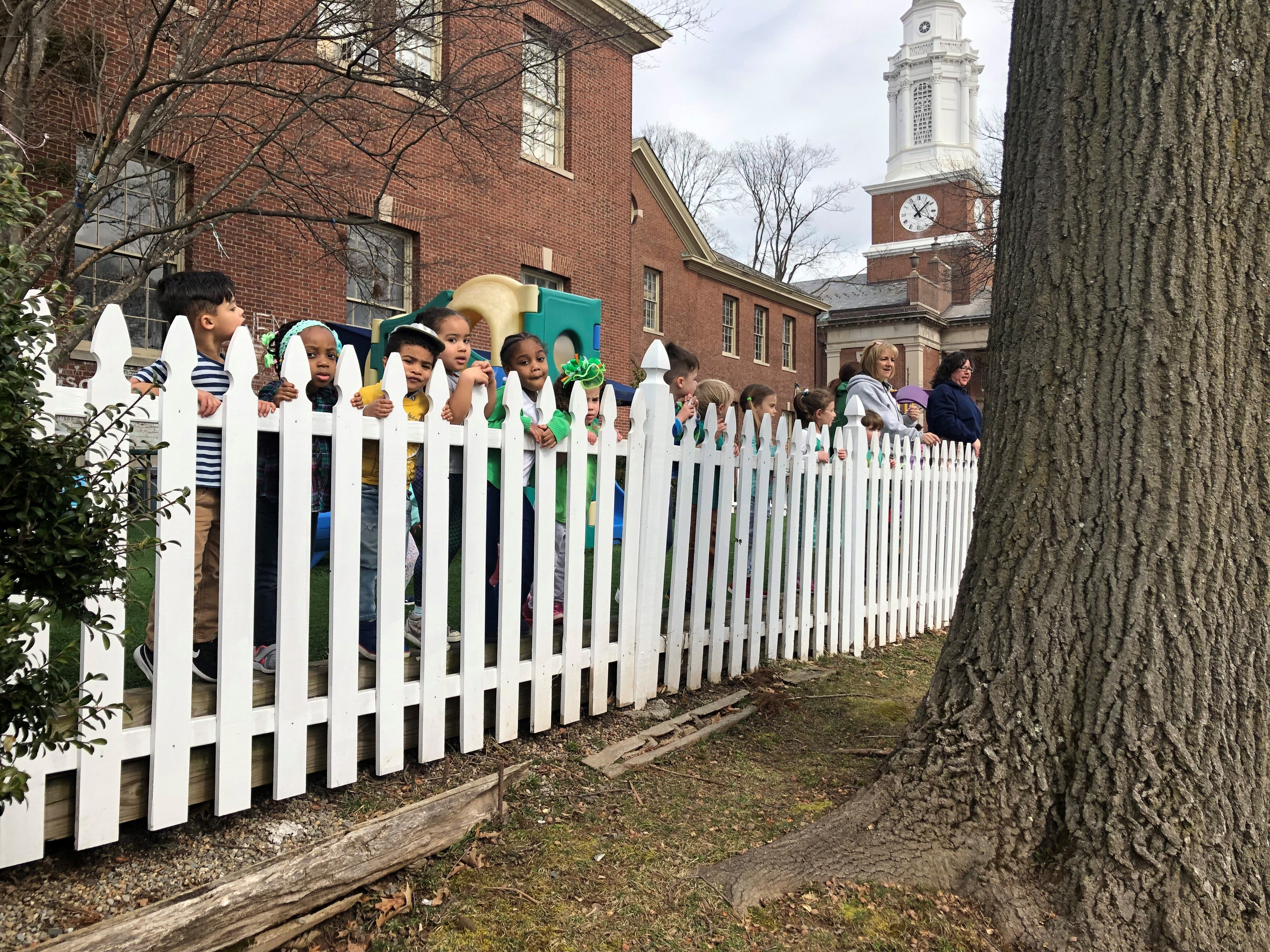 Nursery school children in Montclair watching Montclair High School students march by on a Climate Strike. March 15, 2019.
