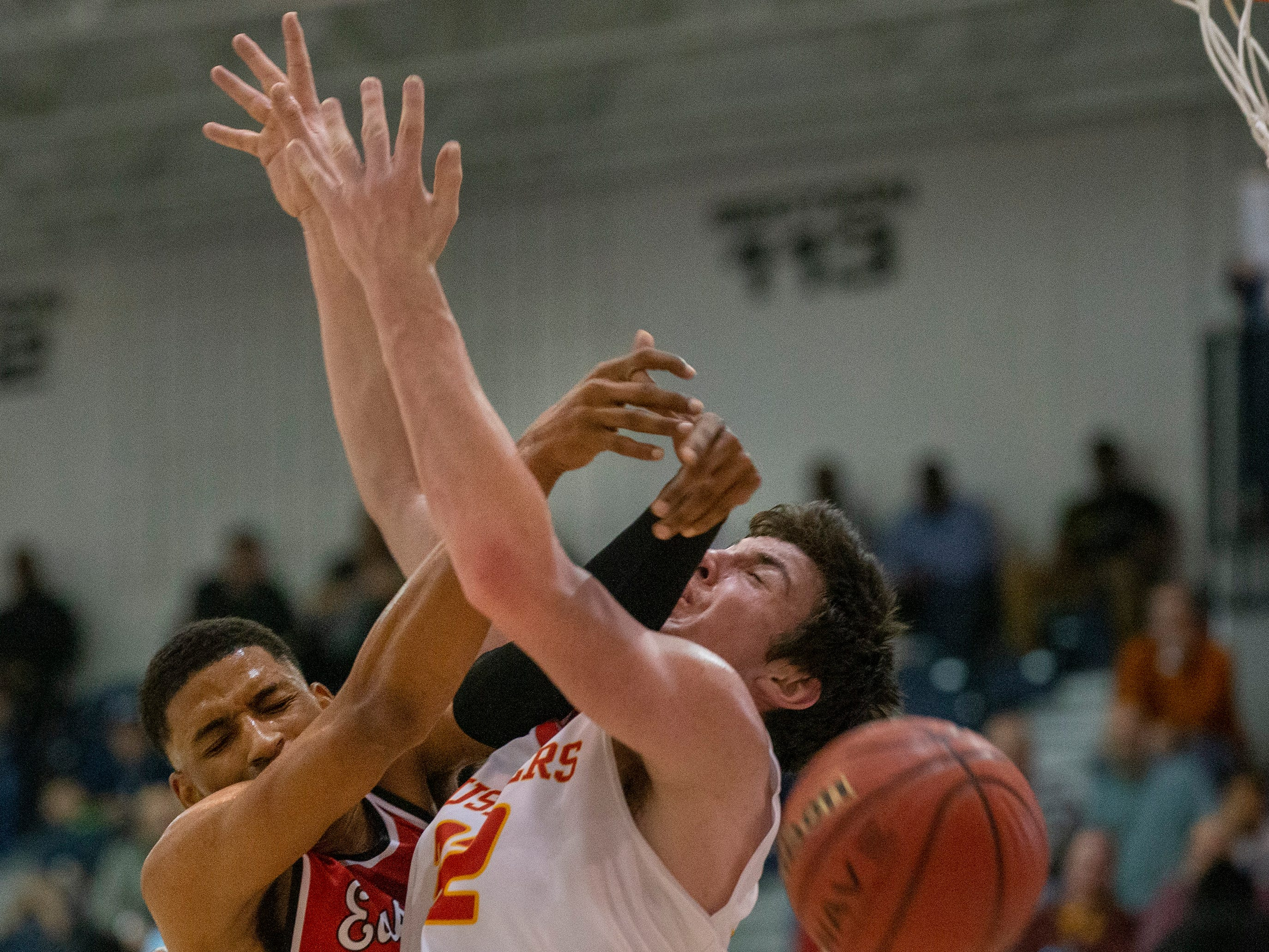 Mikah Johnson, East Side Newark, hits Zachary Freemantle in face during first half action. Bergen Catholic vs. Newark East Side in the 5:30 p.m. semifinals of the 2019 NJSIAA Tournament of Champions in Toms River on March 15, 2019.
