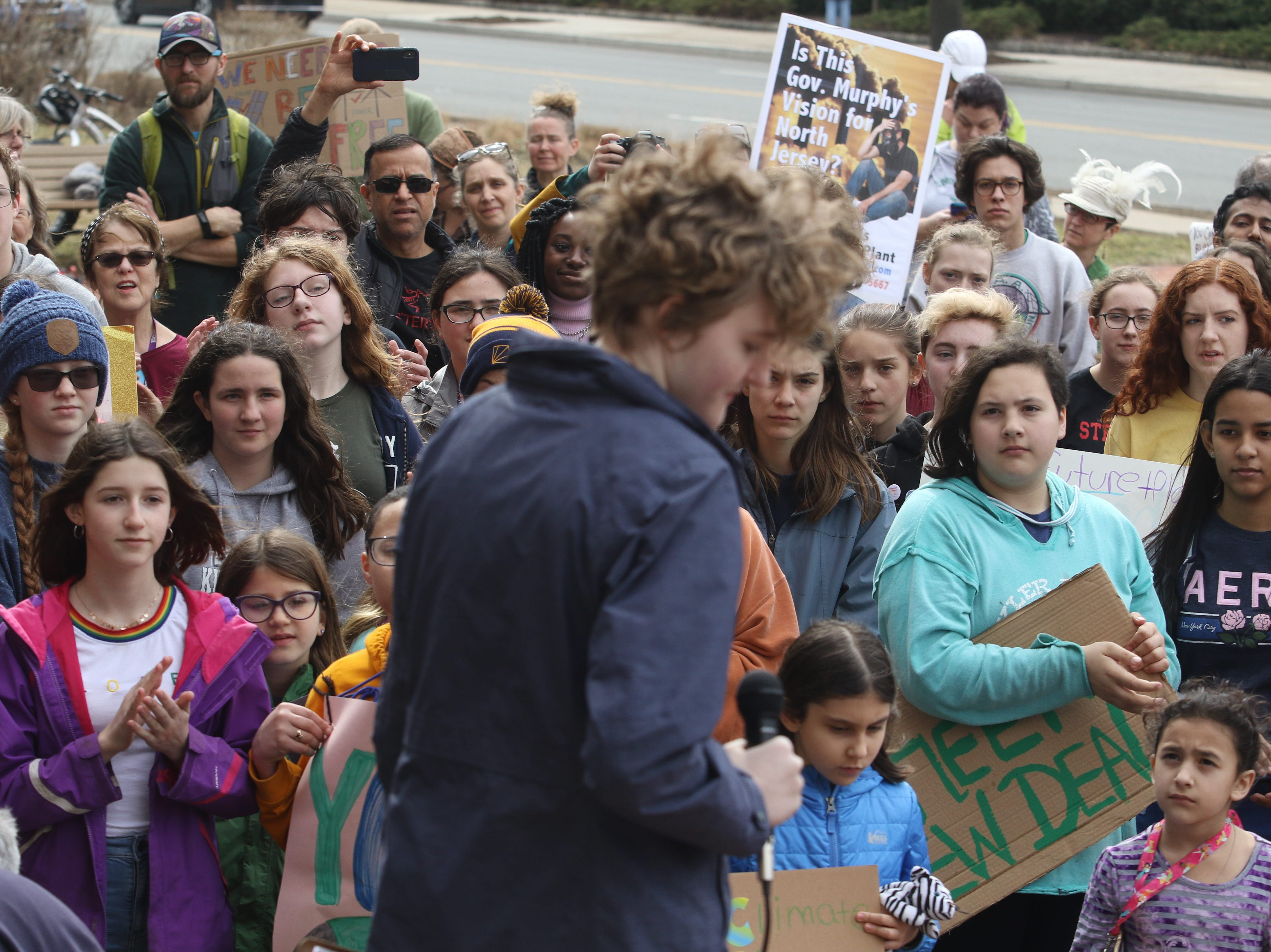 The crowd of students applaud Eden Summerlin 16 of Madison after she addressed the protesters in front of the Morristown Municipal Building on March 15, 2019 to express their demands to address climate change.