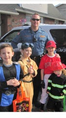 New Milford Police Lt. Brian Clancy will come the borough's new police chief starting on May 1. Clancy is seen in photo with children at an event in New Milford last Halloween.