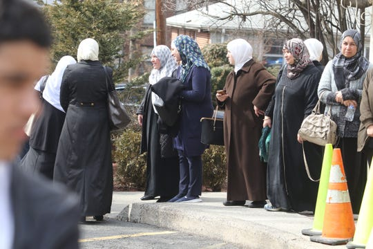 Worshipers wait outside the Islamic Center of Passaic County following afternoon prayer on March 15, 2019. 